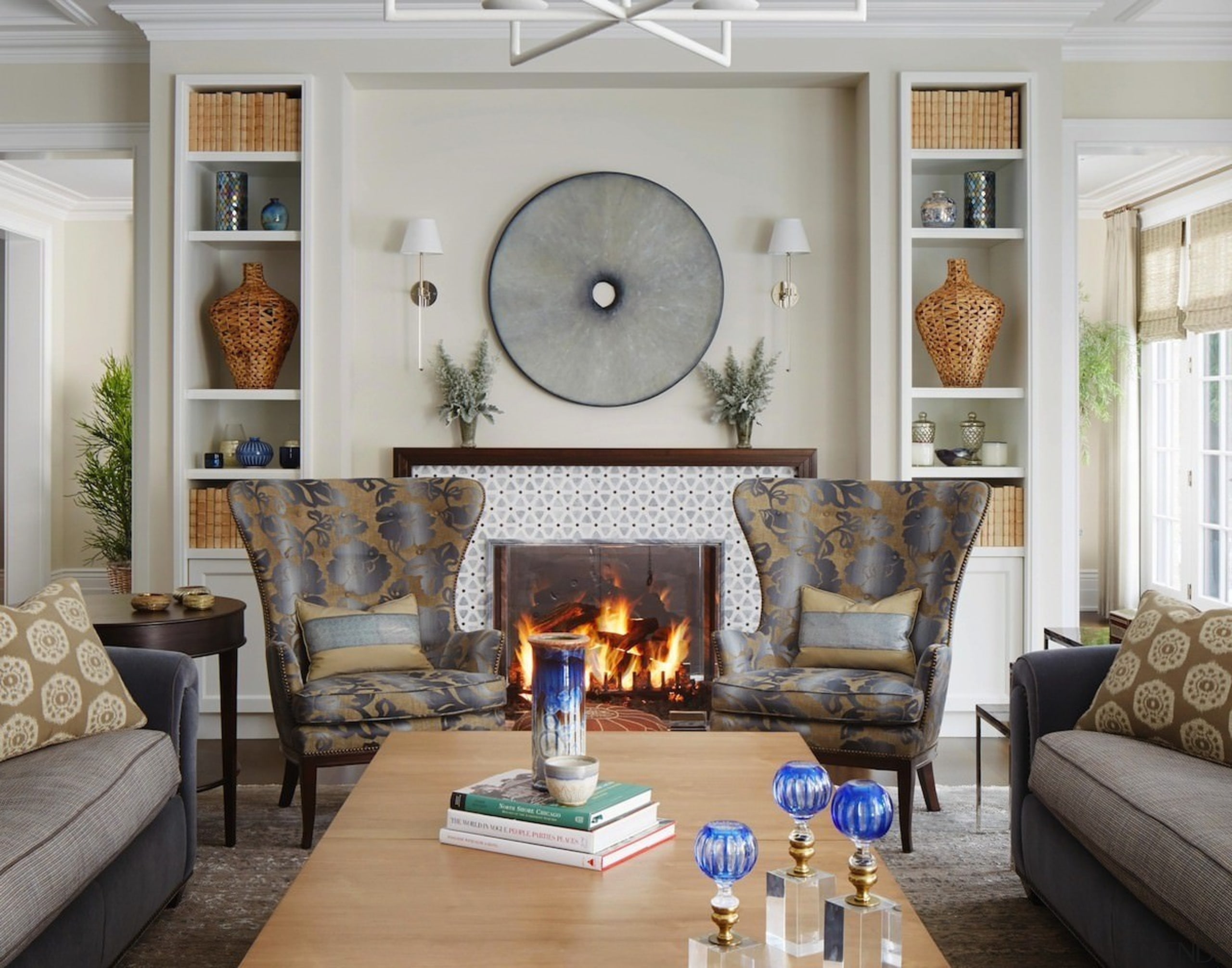 Little can beat a fireplace in winter - couch, furniture, hearth, home, interior design, living room, loveseat, room, wall, gray