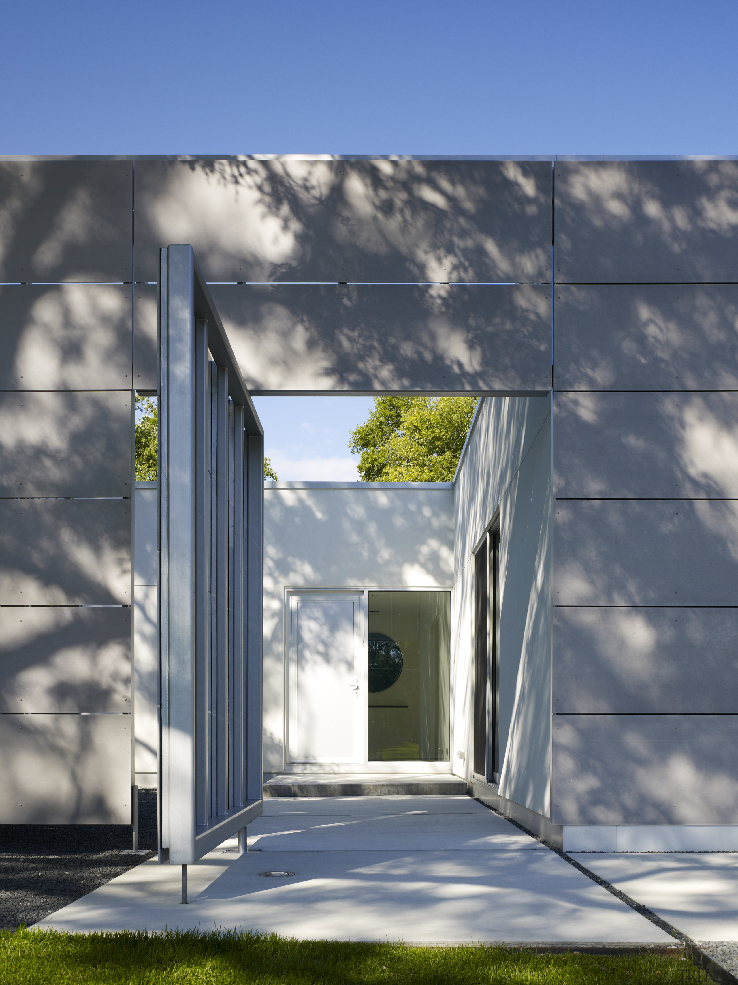 This door leads to an entry courtyard featuring architecture, building, daylighting, facade, home, house, residential area, sky, gray