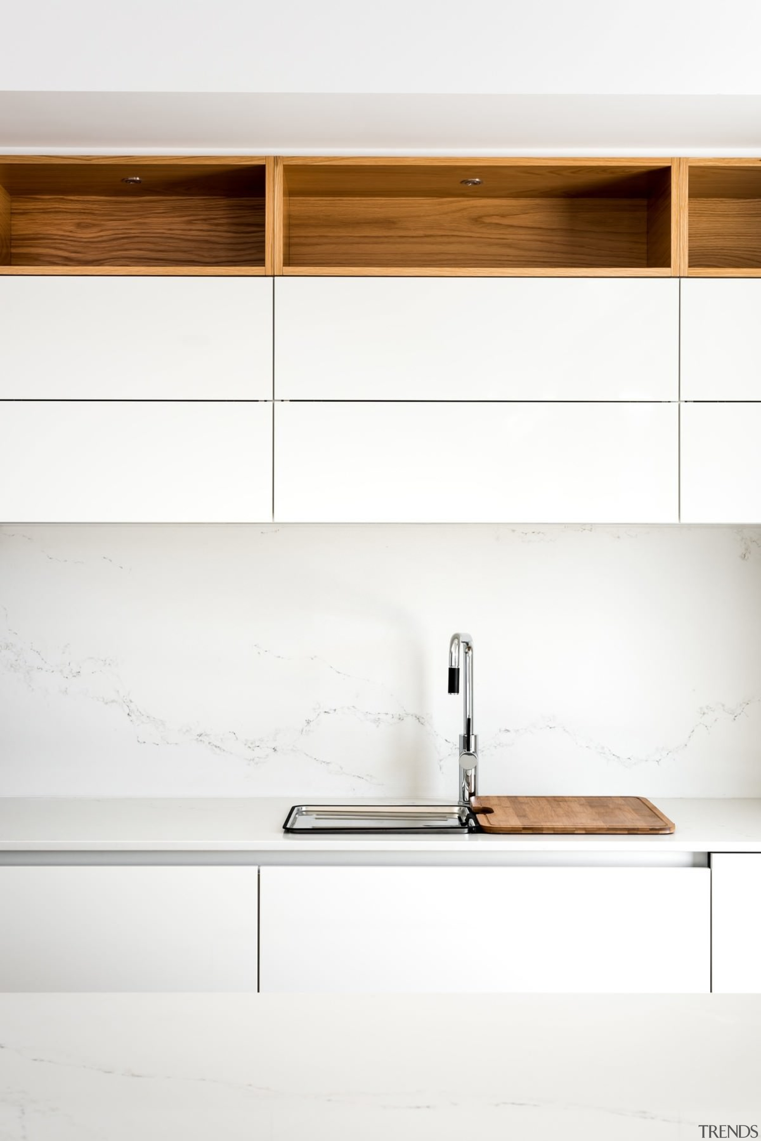 A sink sits below clean cabinets - A floor, furniture, plywood, product, product design, shelf, sideboard, table, tap, wall, wood, white
