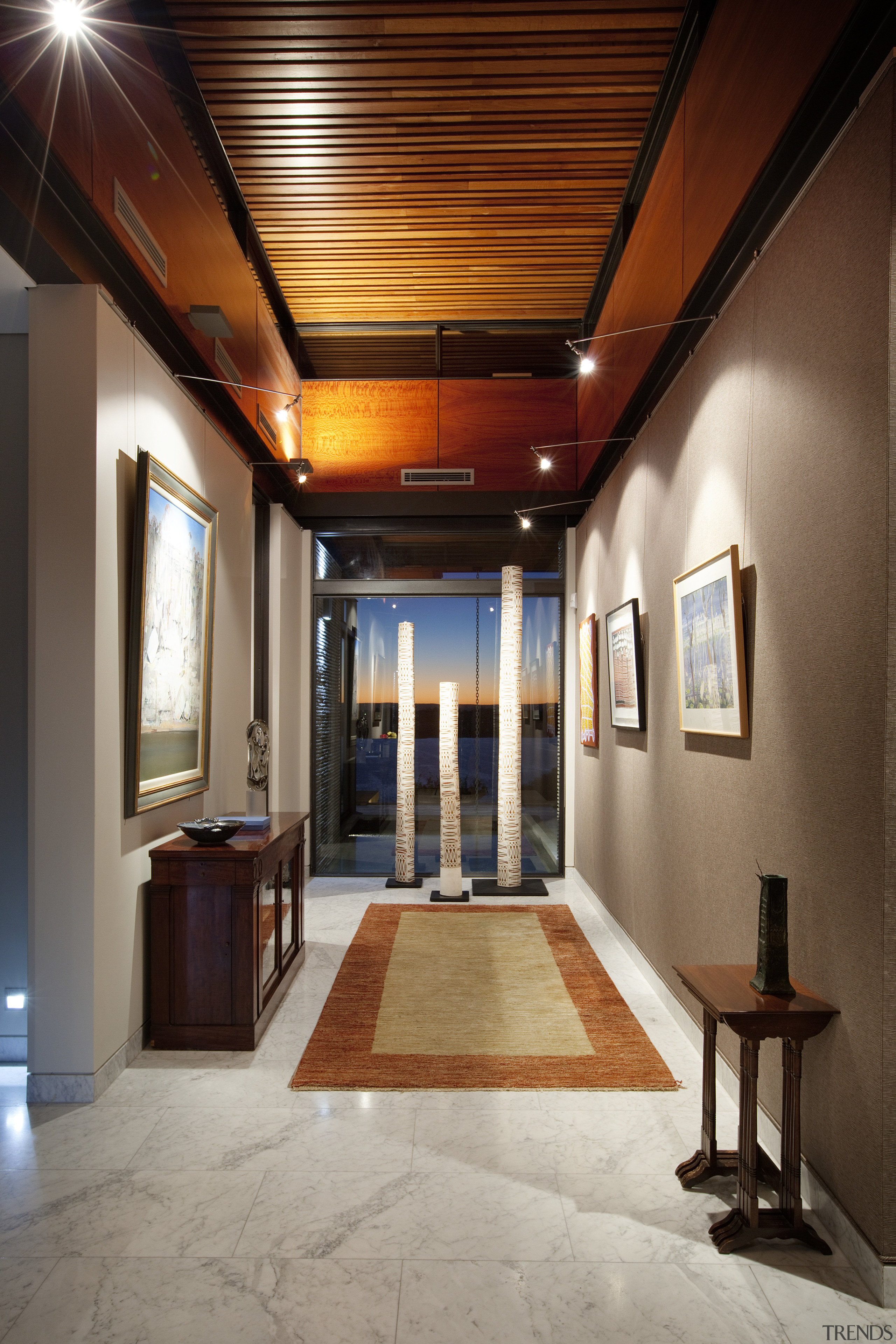 A wide gallery forms a strong axis through ceiling, daylighting, estate, hall, home, interior design, lighting, lobby, real estate, brown, gray