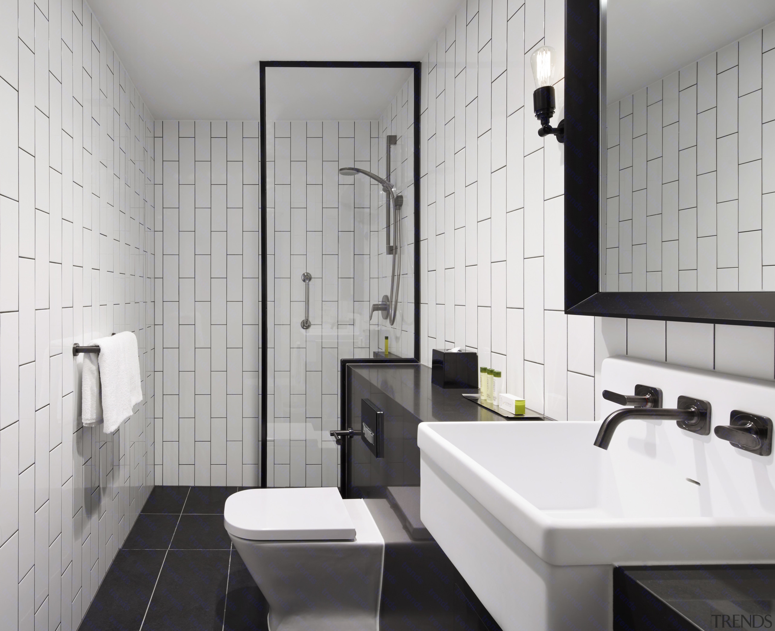 Guest rooms at the new DoubleTree by Hilton bathroom, floor, interior design, plumbing fixture, product design, room, sink, tile, wall, gray