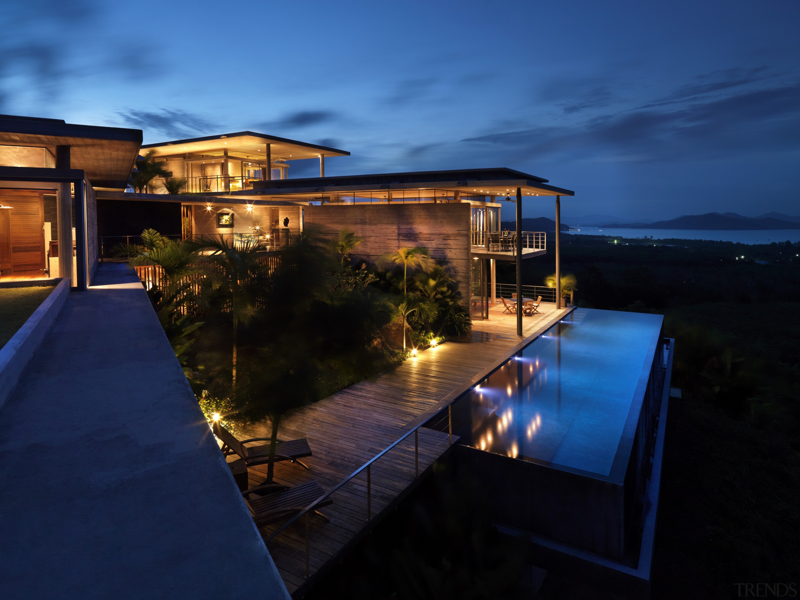 View of modern home designed by Design Unit architecture, dusk, estate, evening, home, house, landscape lighting, lighting, night, property, real estate, reflection, resort, sky, swimming pool, villa, water, blue
