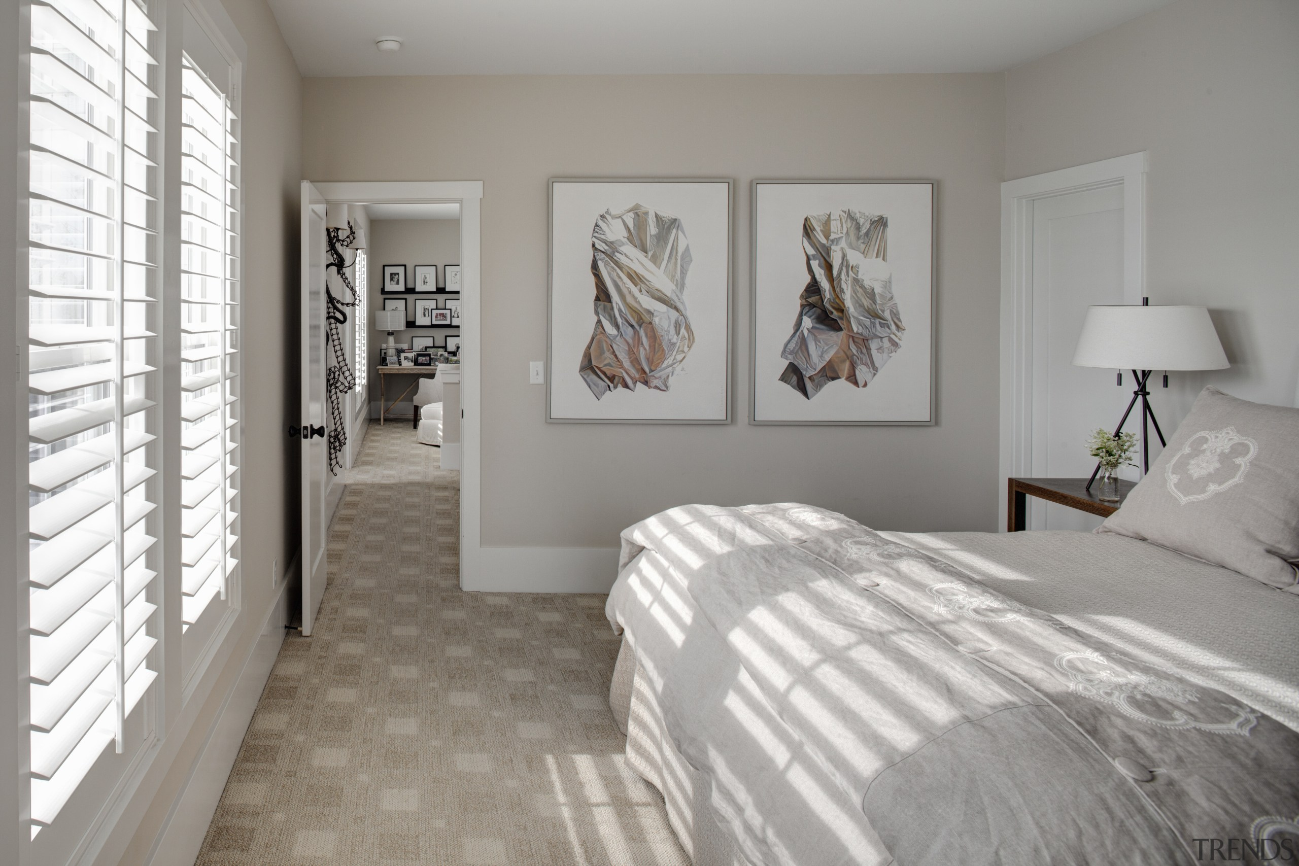 White, wooden shutters filter light into this traditional bedroom, ceiling, floor, flooring, home, interior design, real estate, room, wall, window, gray