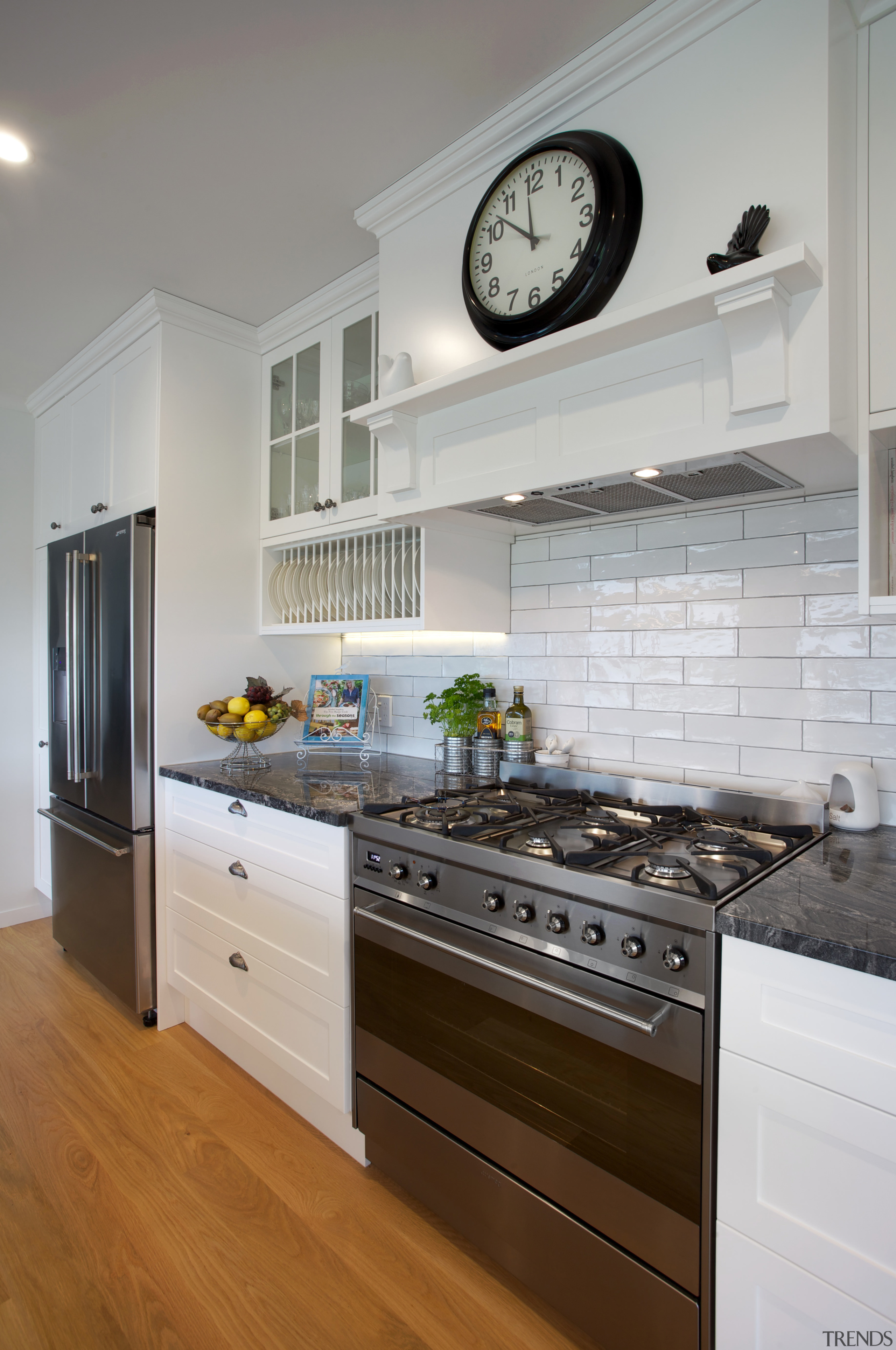 Open, breezy and welcoming, this kitchen designed by cabinetry, countertop, cuisine classique, floor, home, home appliance, interior design, kitchen, kitchen appliance, kitchen stove, room, gray