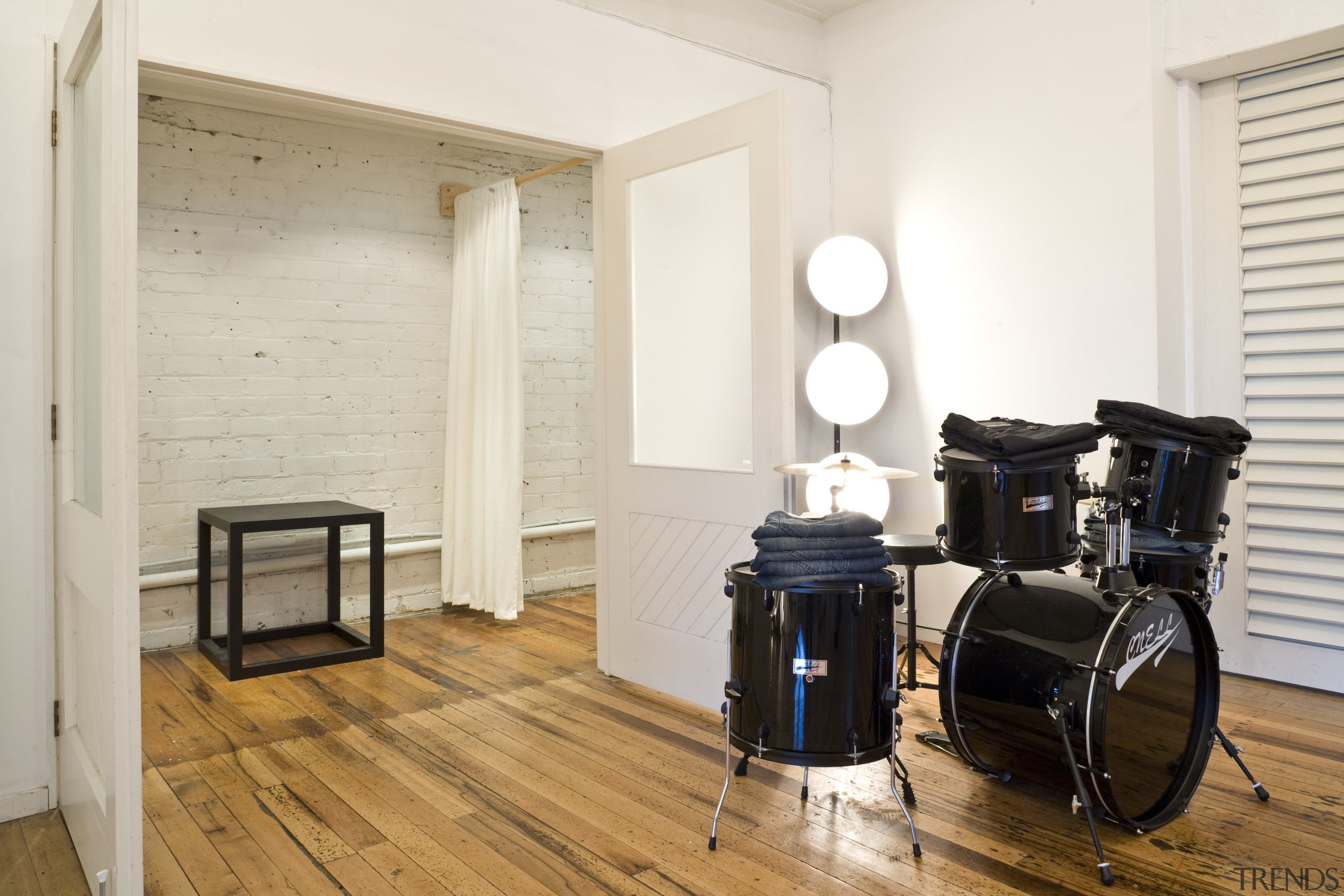 View of a drum kit which is used floor, flooring, hardwood, home, interior design, room, wood, wood flooring, white