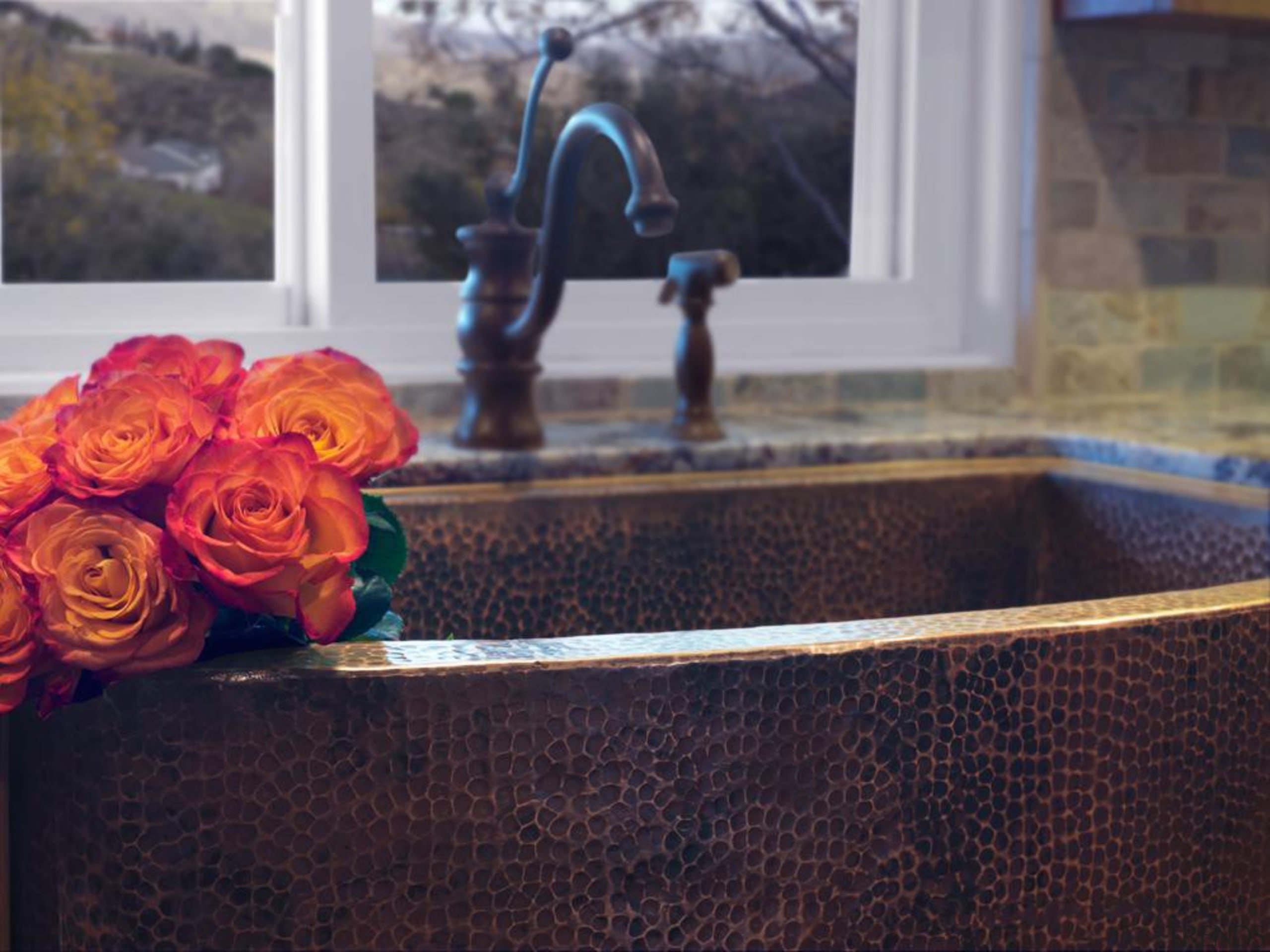 Hammered copper farm sink. - Hammered copper farm flooring, flower, plant, wood, yellow, black, gray