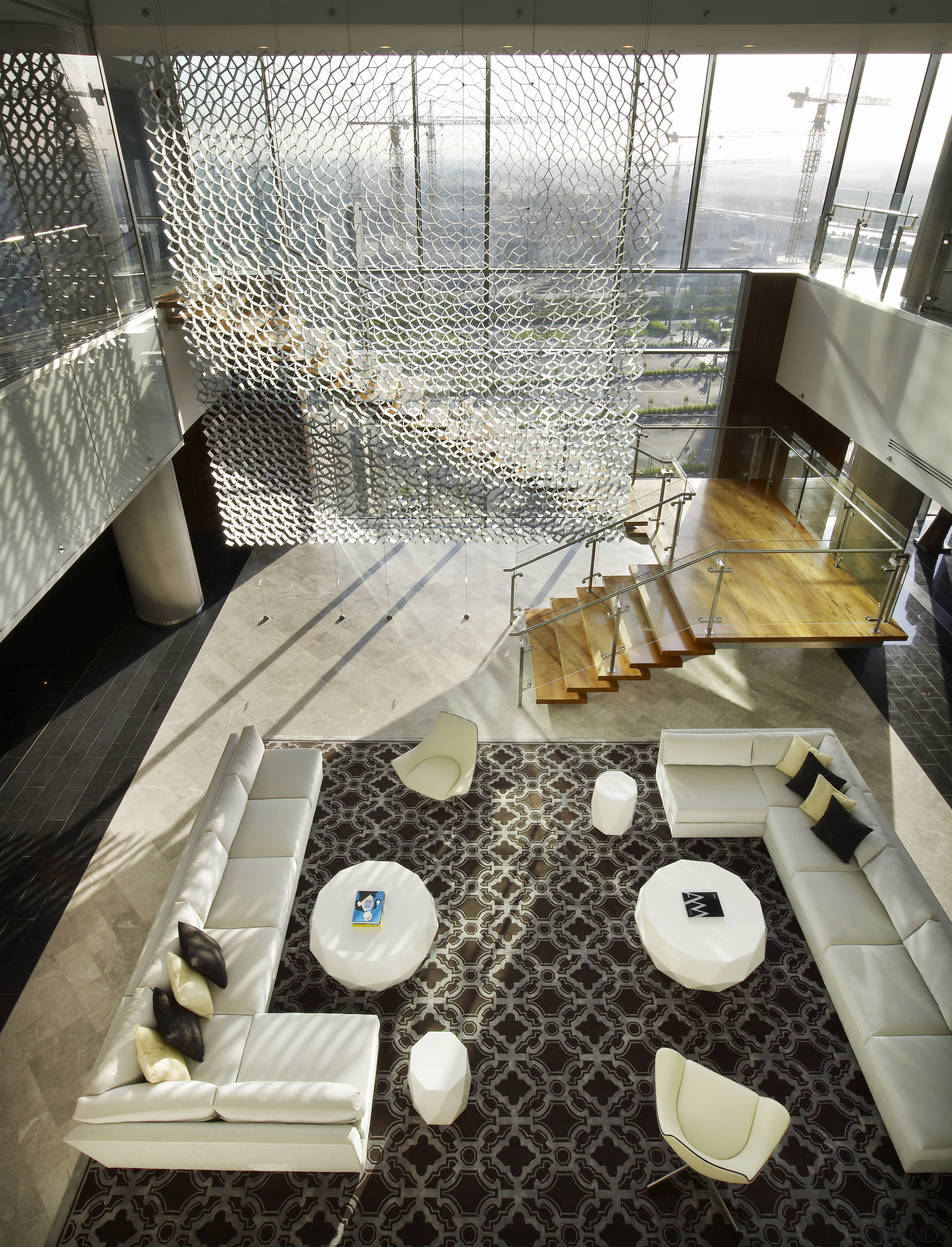 View down to lower story with white couch architecture, flooring, interior design, table, white, black