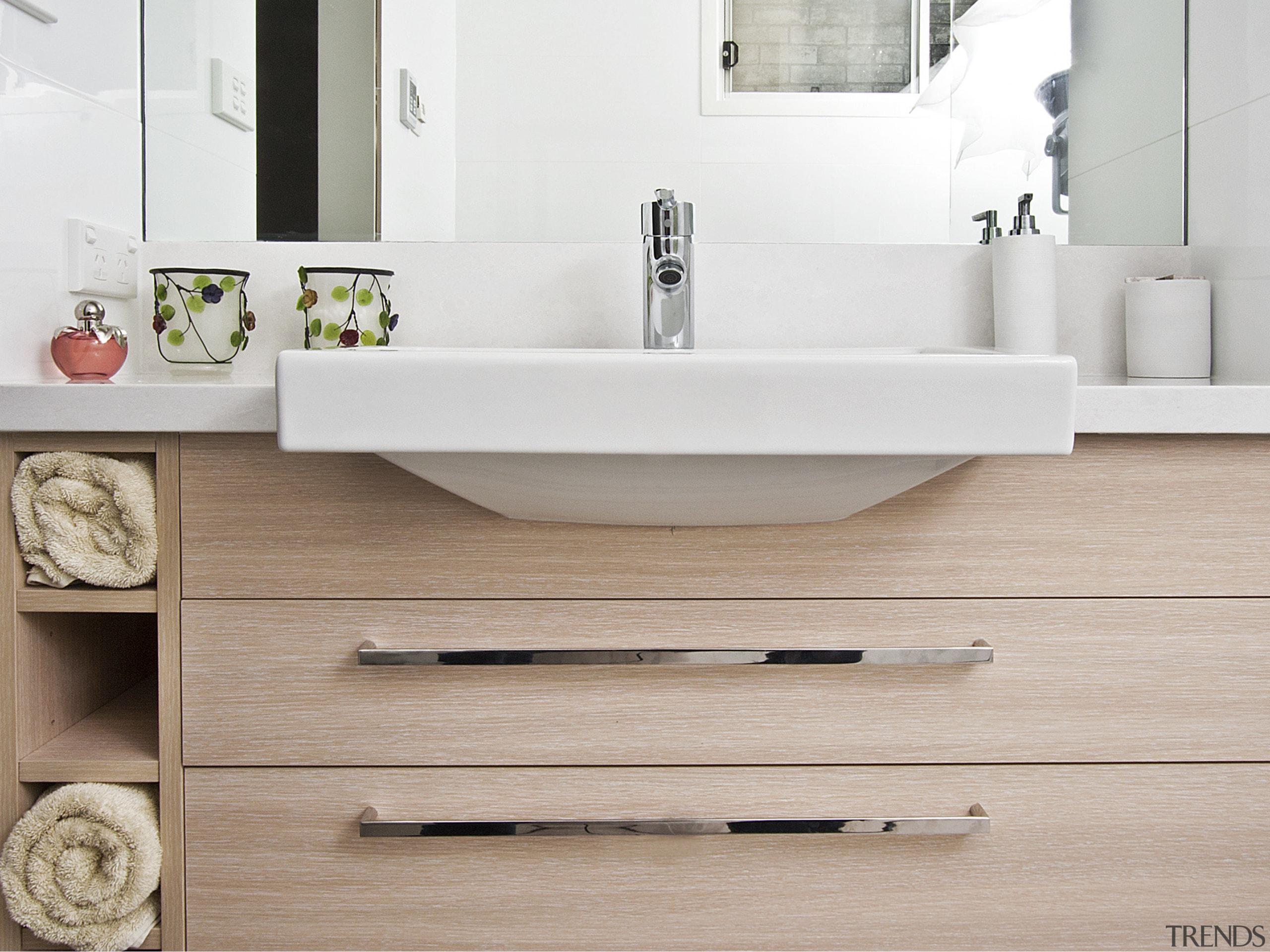View of bathroom featuring wood floors, white bench bathroom, bathroom accessory, bathroom cabinet, bathroom sink, ceramic, floor, plumbing fixture, product design, sink, tap, gray
