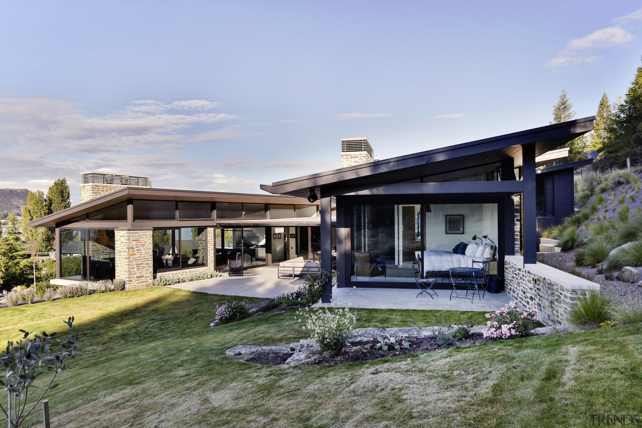 This homes master pavilion sits slightly higher on architecture, cottage, elevation, estate, facade, home, house, landscape, property, real estate, villa, teal