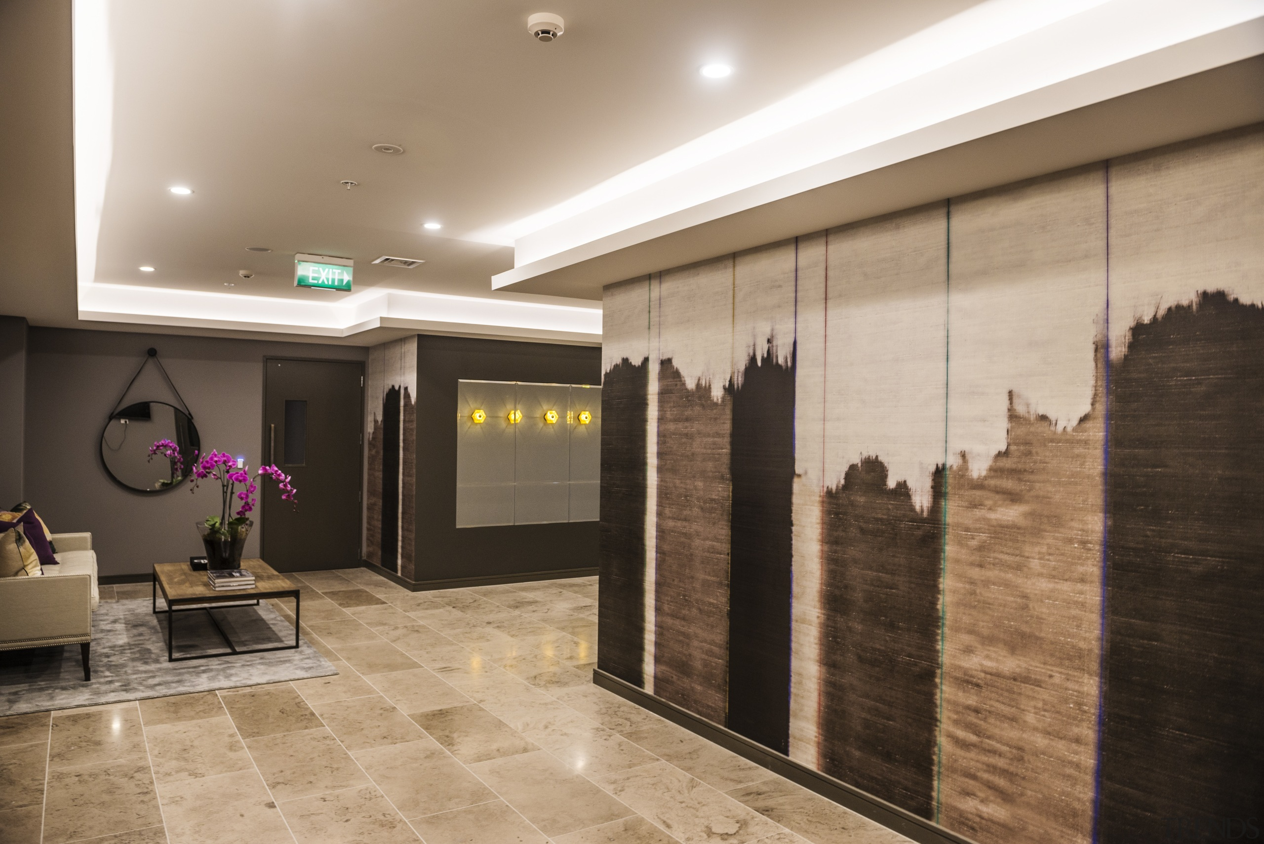 A distressed-look designer wallpaper provides a contemporary feature ceiling, floor, flooring, interior design, lobby, wall, orange, brown