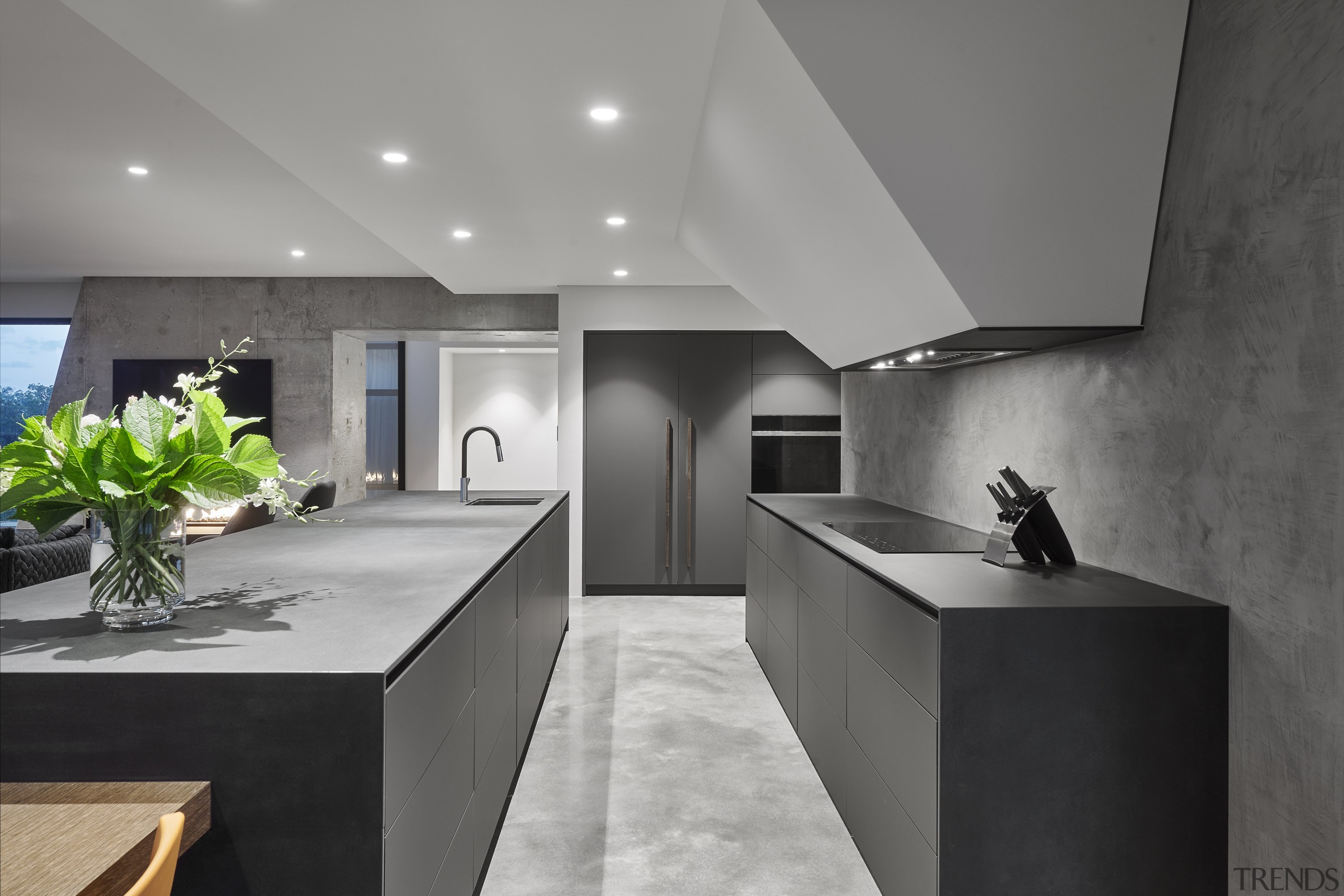 Recessed pulls accentuate the kitchen's minimalist lines while