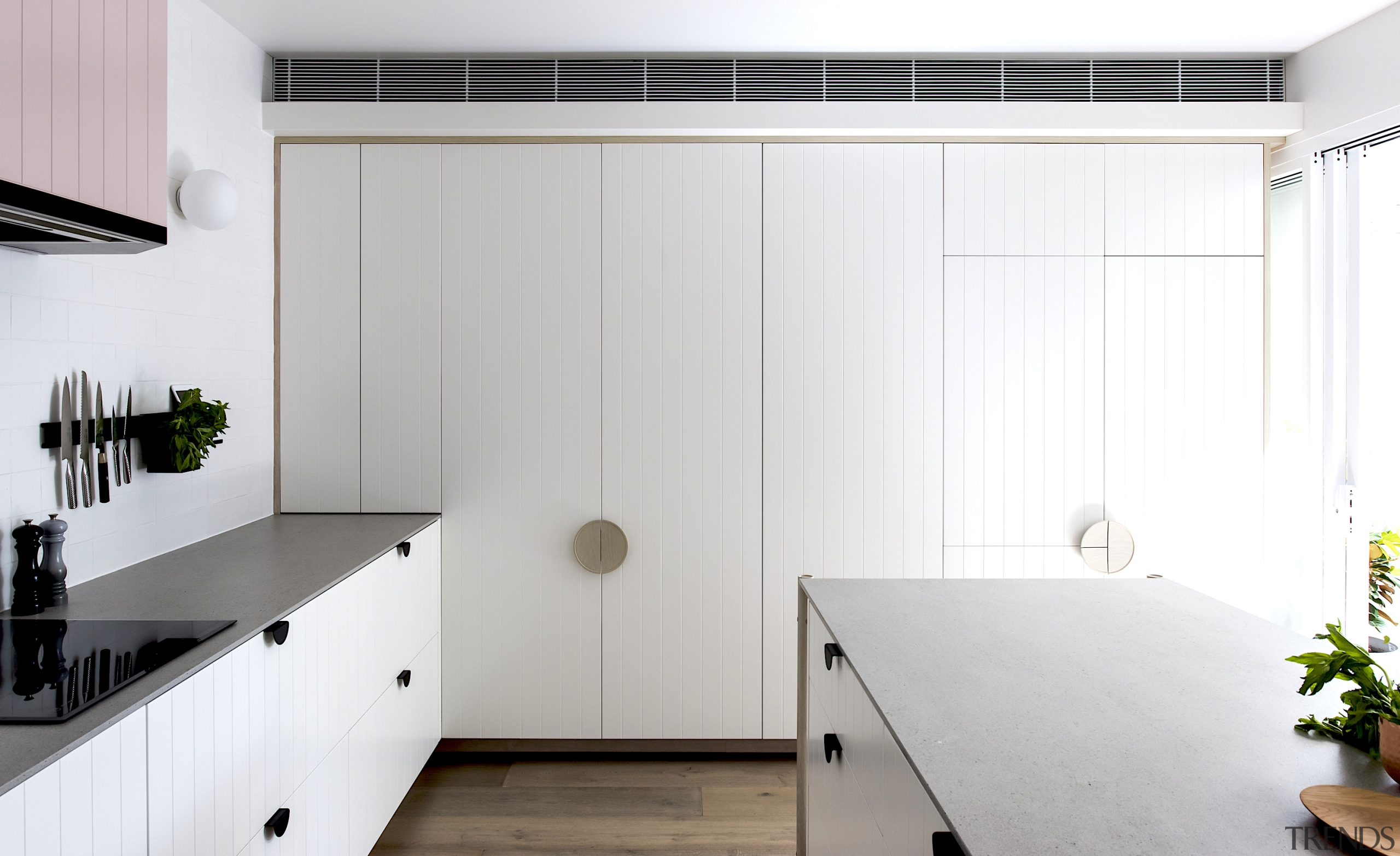 Behind closed doors – a wall of cabinetry white
