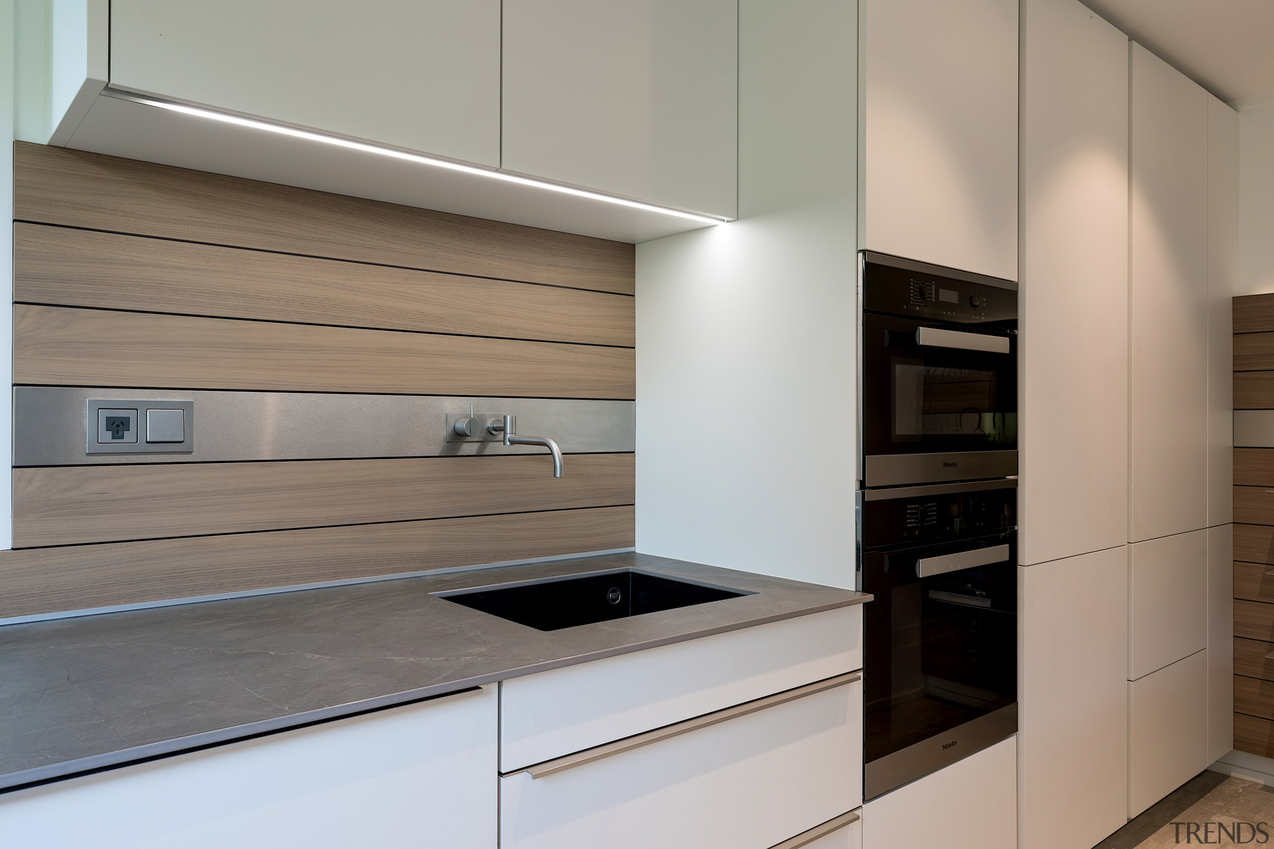 Understated satin lacquer cabinetry helps to blend this architecture, building, cabinetry, ceiling, countertop, cupboard, drawer, floor, furniture, home, home appliance, house, interior design, kitchen, material property, plywood, property, real estate, room, gray