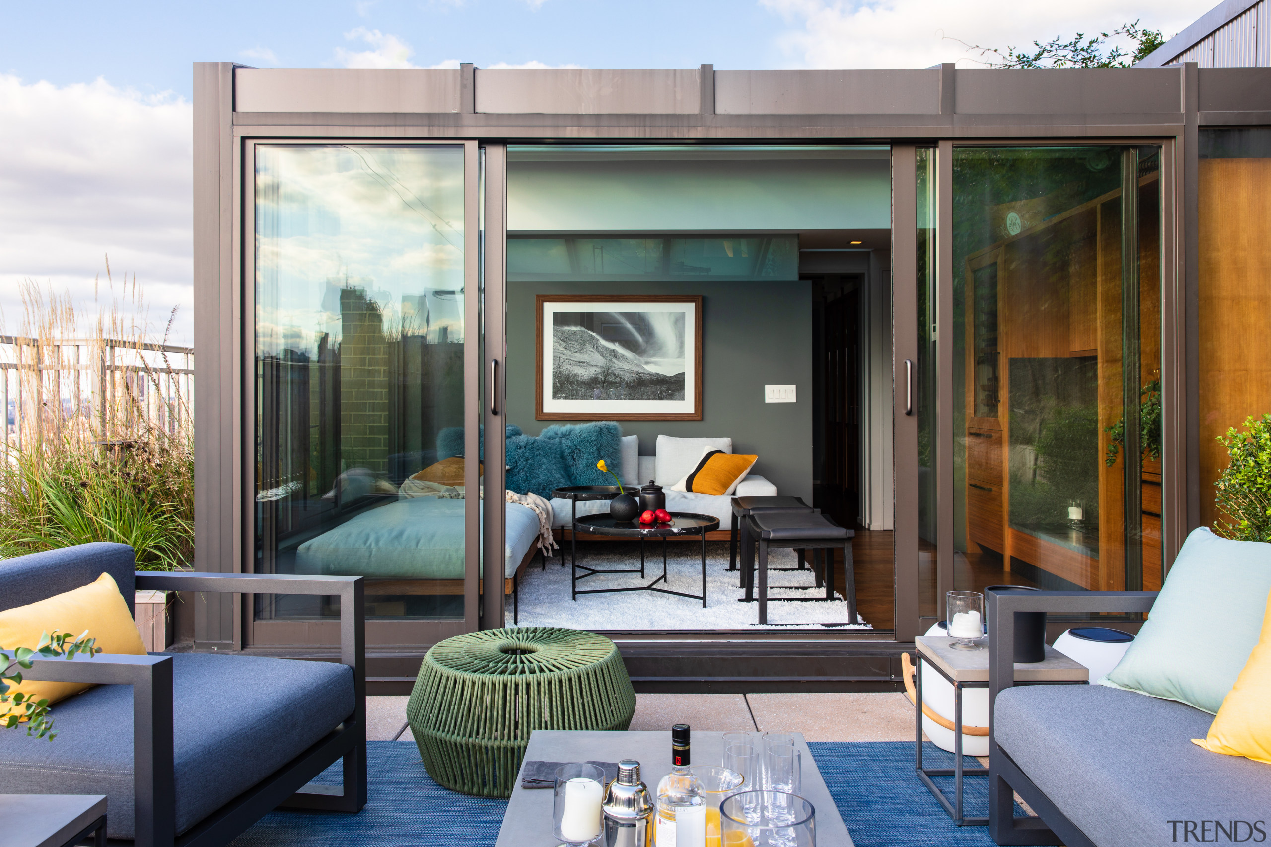 Perched on top of a Manhattan duplex, this architecture, penthouse, outdoor deck, outdoor furniture, home, interior design, couch, suite, table, Andrew Wilkinson