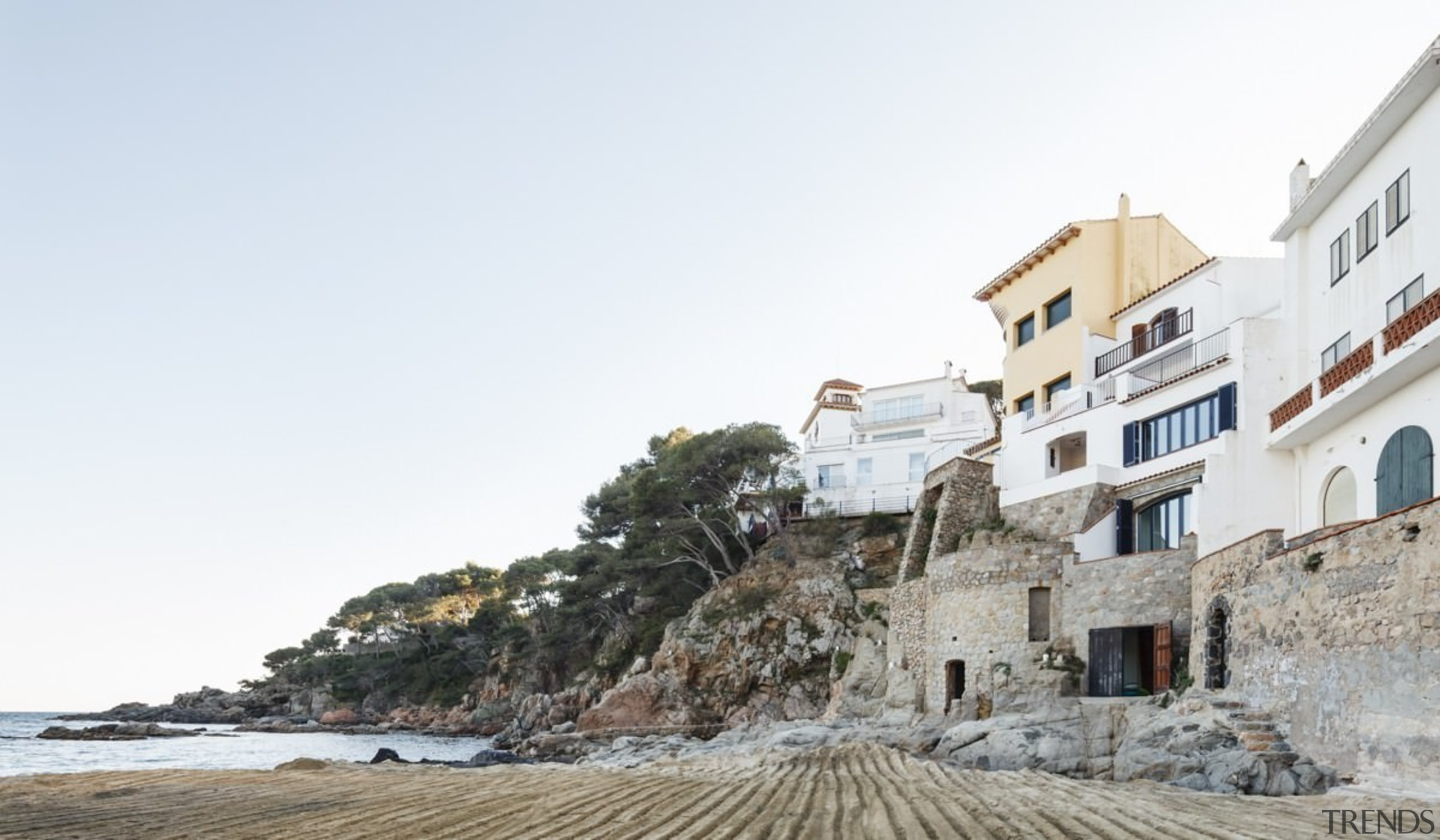 A view of the property from down on beach, building, coast, coastal and oceanic landforms, property, sea, sky, terrain, tourism, white