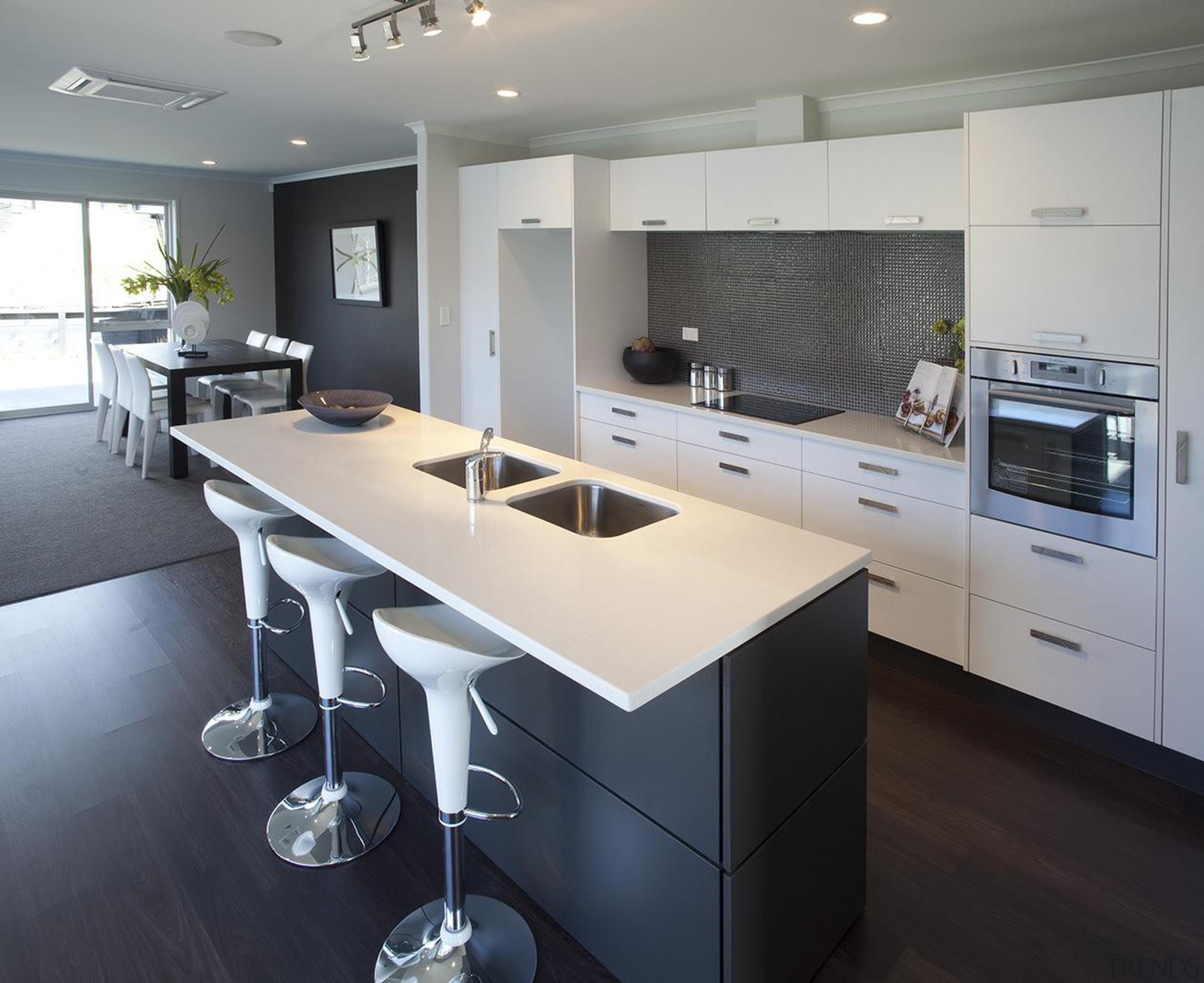 For more information, please visit www.gjgardner.co.nz countertop, interior design, kitchen, real estate, room, gray, black