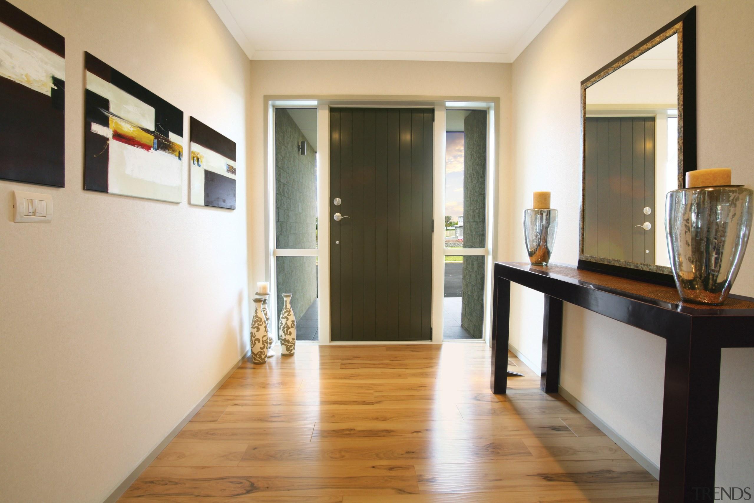 interior view of front entrance of this Platinum floor, flooring, interior design, real estate, room, white, orange