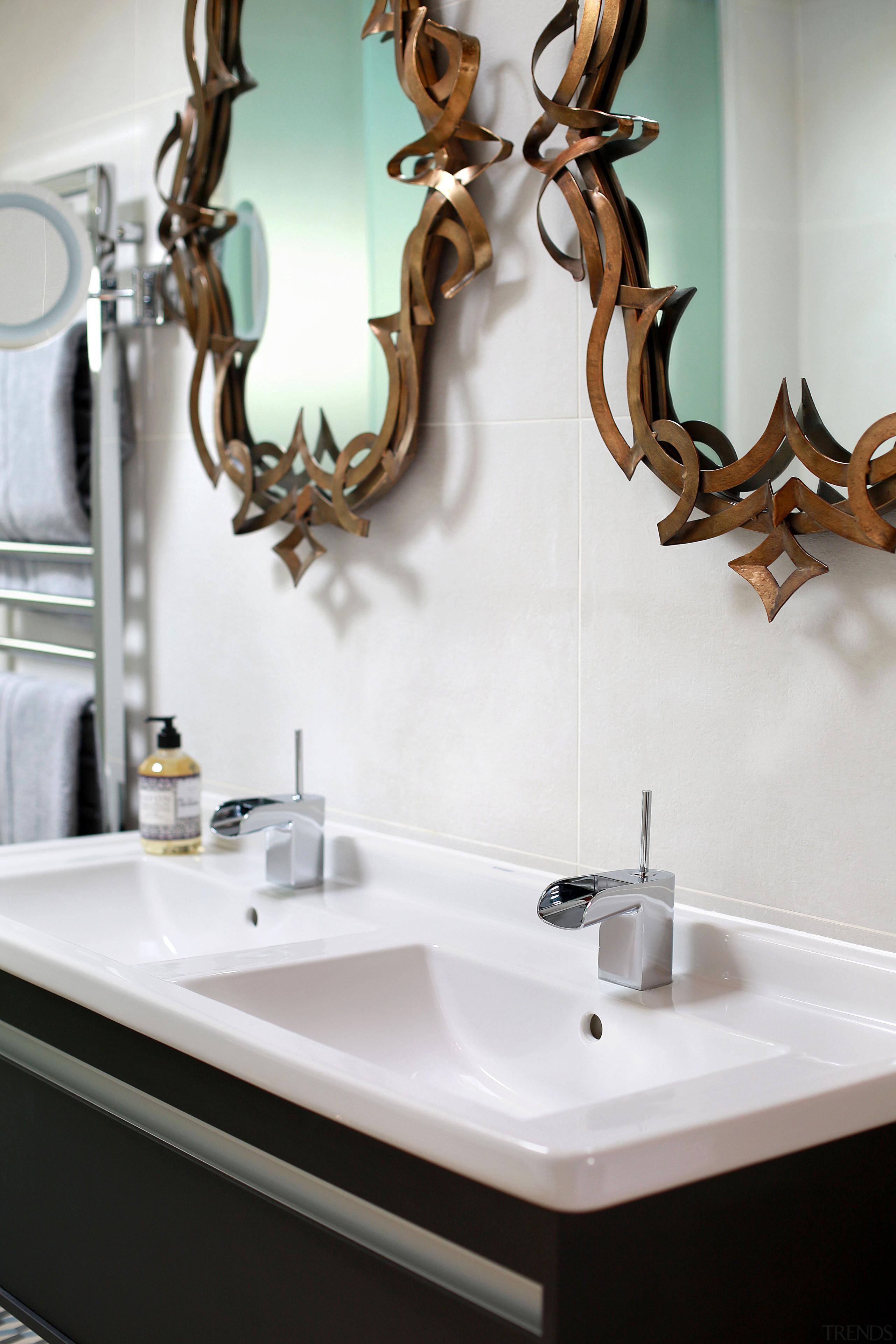 Recessed pulls on this vanity contribute to the bathroom, ceramic, interior design, plumbing fixture, room, sink, tap, white
