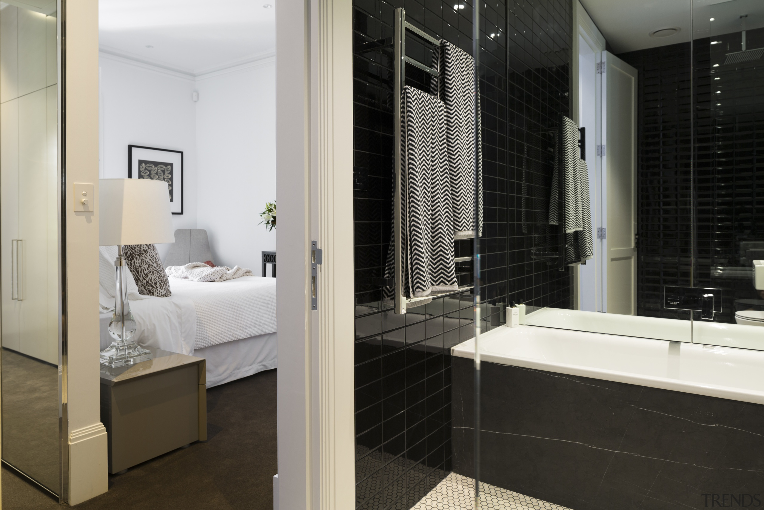 This renovated city residence now has three and bathroom, floor, flooring, interior design, room, suite, black, gray