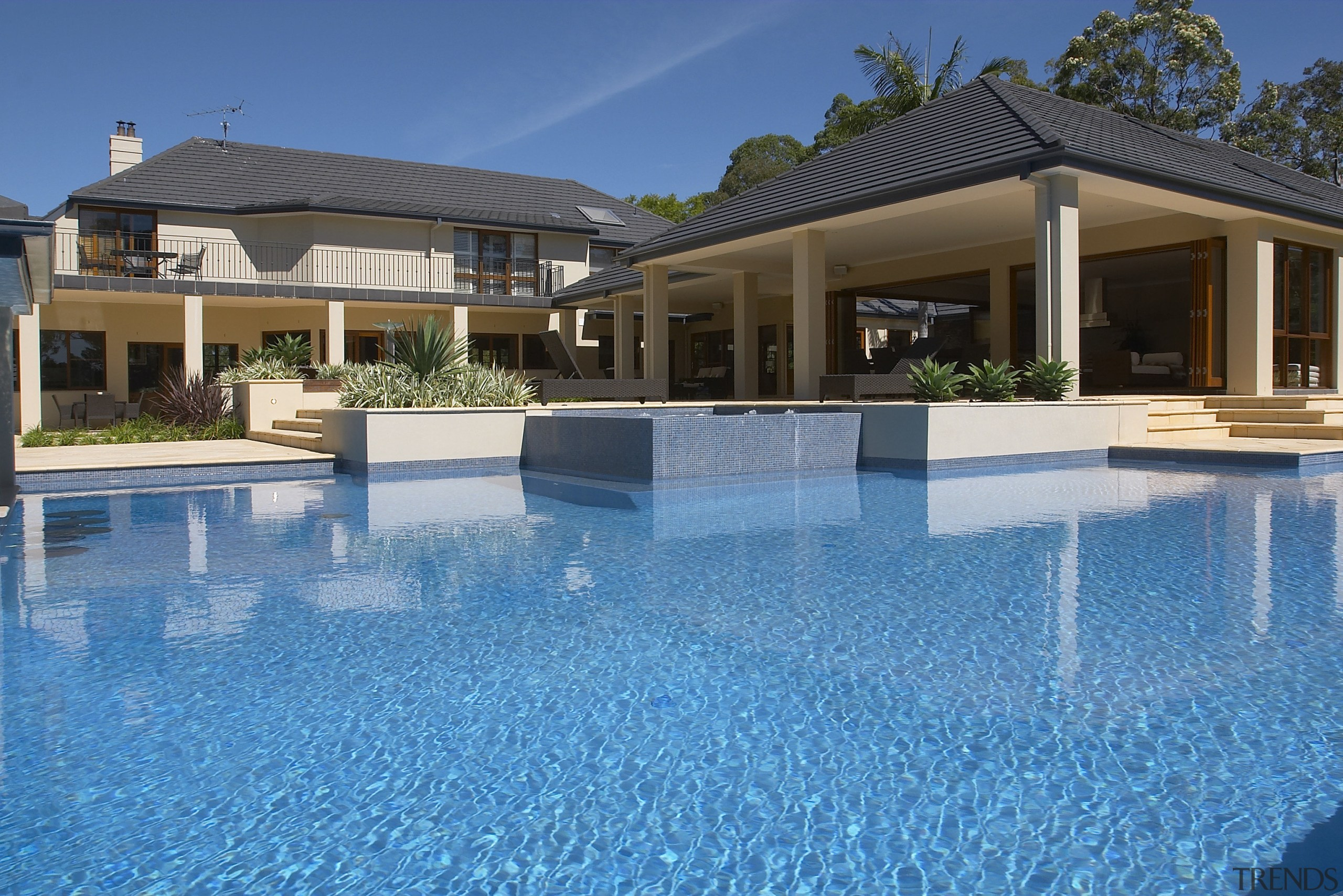 Exterior view of a home which was designed cottage, estate, home, house, leisure, mansion, property, real estate, resort, resort town, swimming pool, villa, water, teal