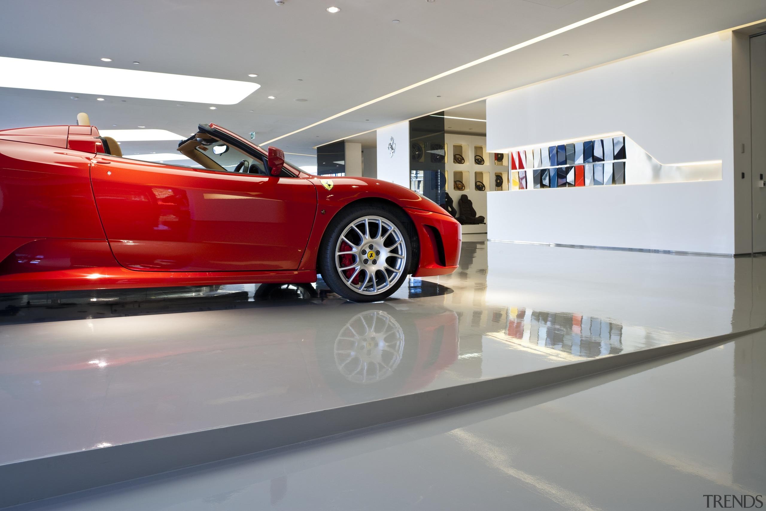 Ferrari Showroom in Australia - Ferrari Showroom in auto show, automotive design, car, luxury vehicle, motor vehicle, race car, sports car, supercar, vehicle, gray