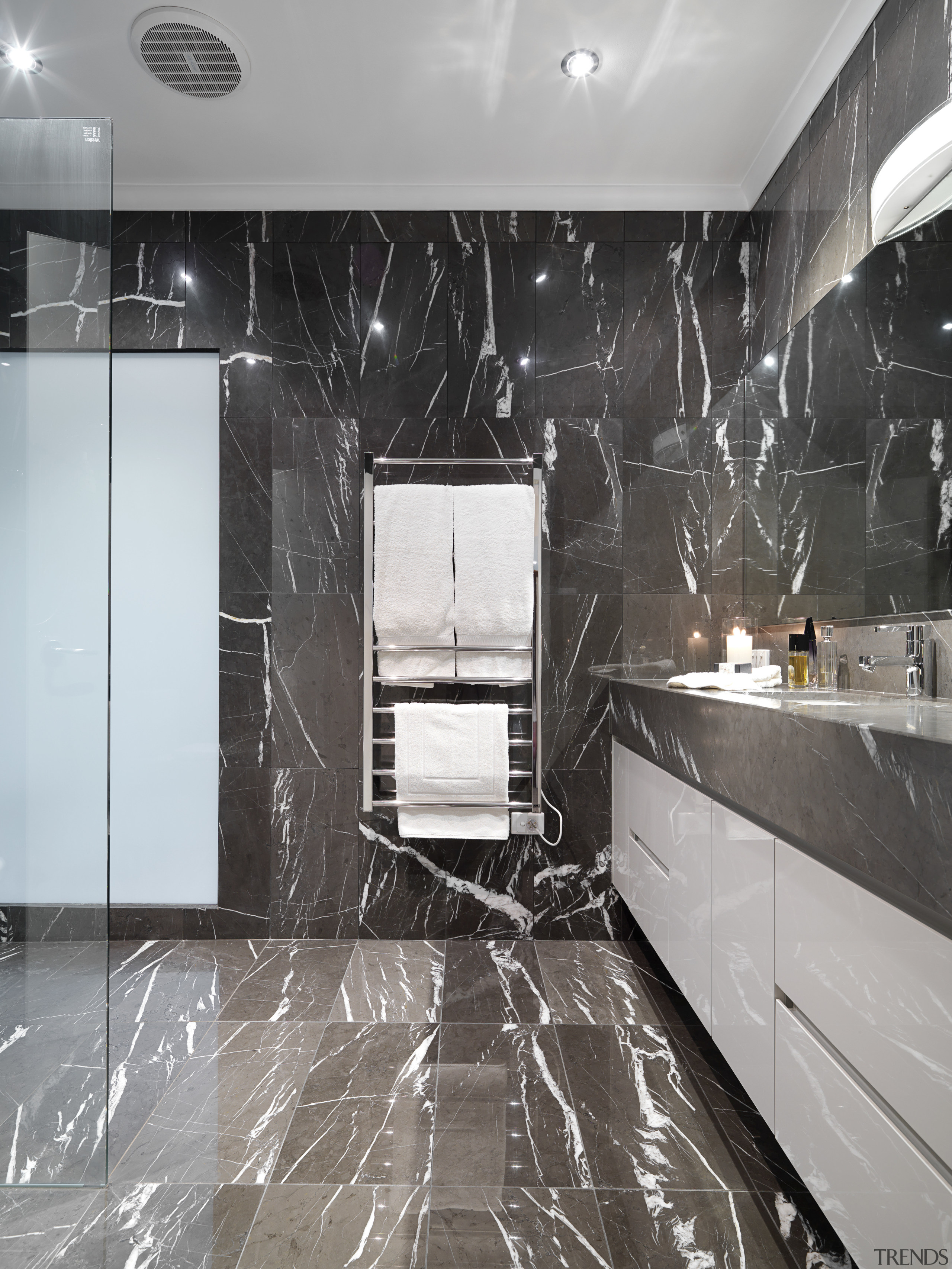 View of bathroom which features chocolate-coloured marble floor ceiling, countertop, floor, flooring, interior design, room, tile, wall, gray, black