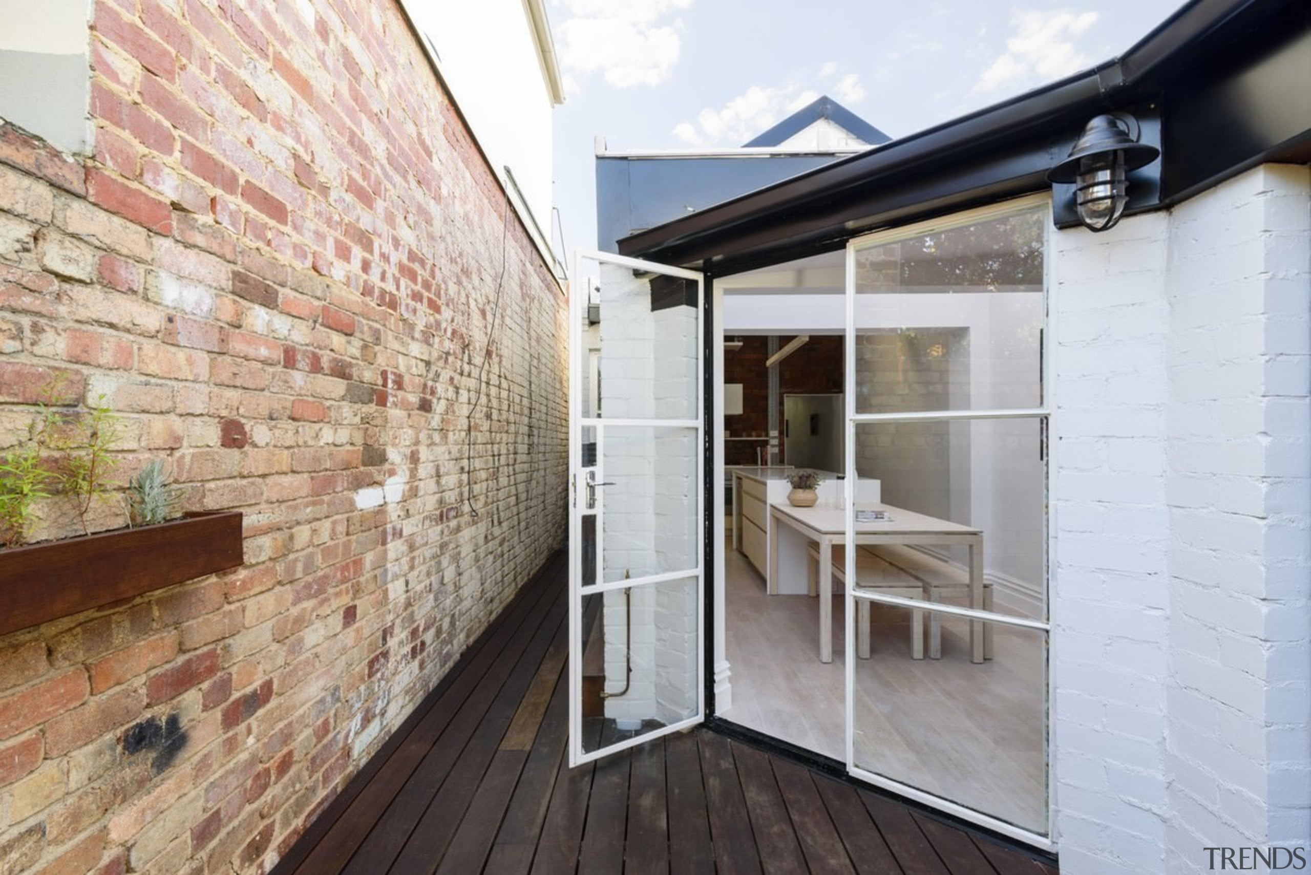 Large glass doors lead out to the courtyard architecture, daylighting, house, interior design, property, real estate, wall, white