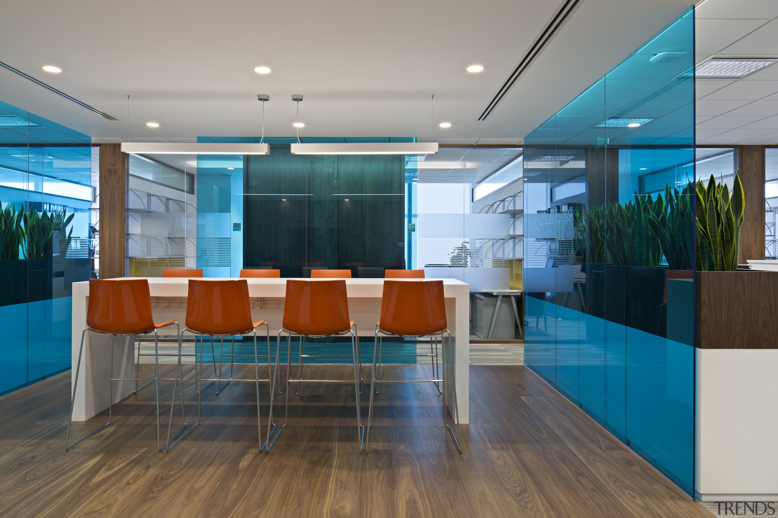 Bright orange stools provide a colourful accent in ceiling, interior design, lobby, office, table, gray, teal