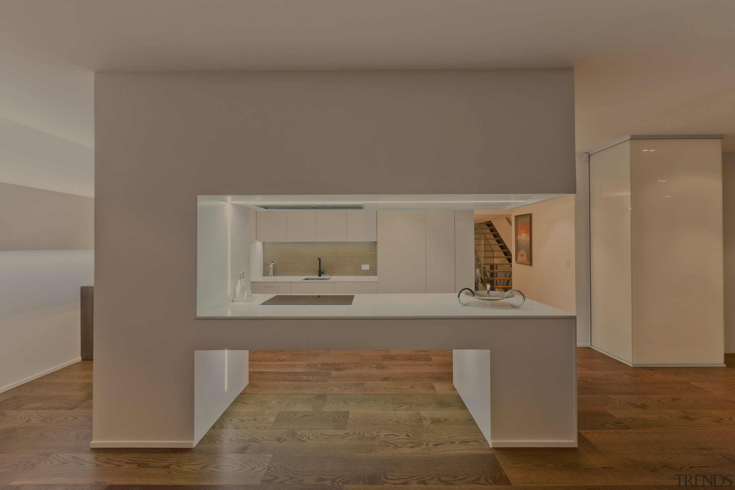 A view of a kitchen designed by Celia fireplace, floor, furniture, hearth, interior design, product design, table, brown