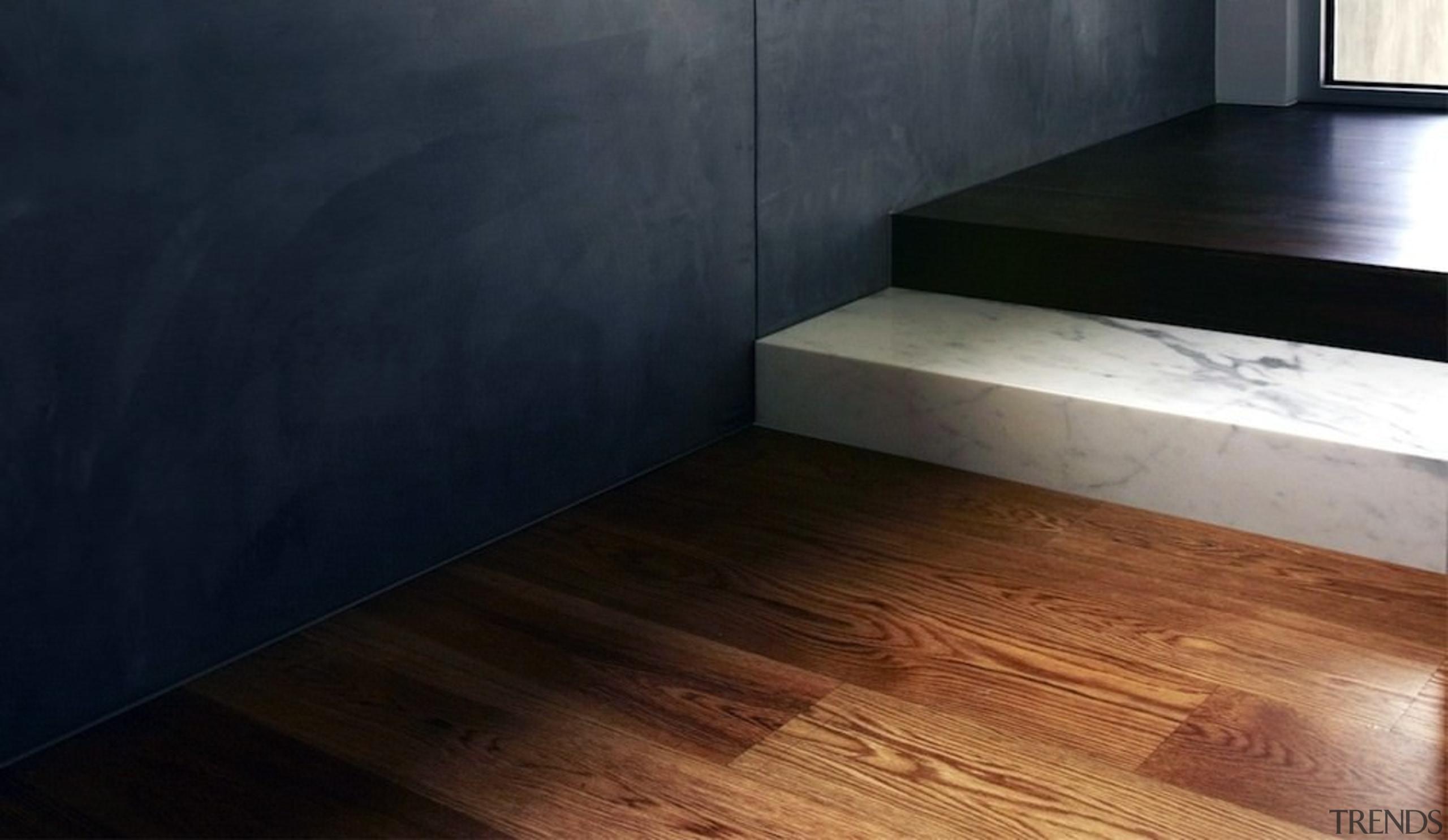 Contrasting materials meet here - Contrasting materials meet floor, flooring, hardwood, laminate flooring, property, wood, wood flooring, wood stain, black