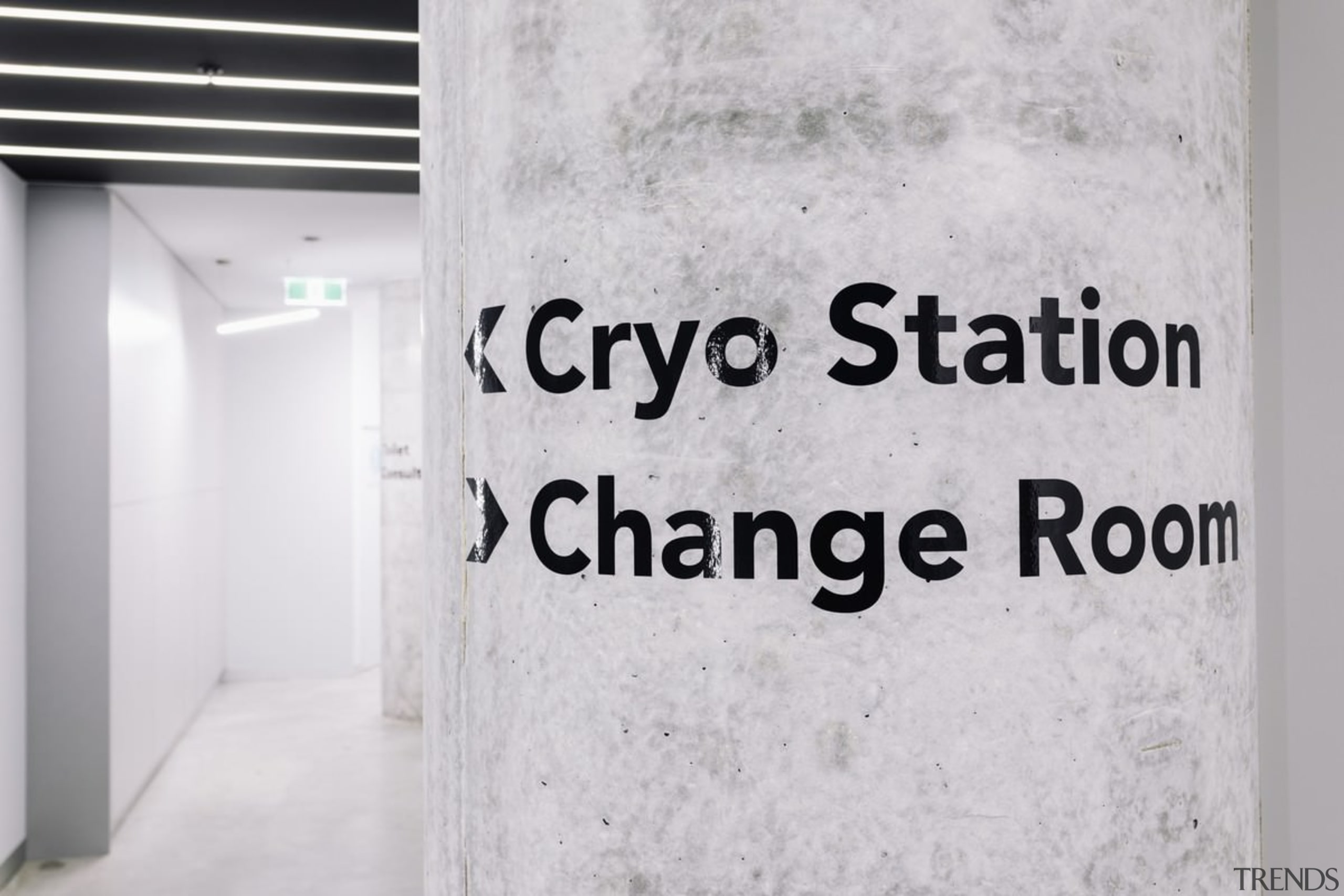 A closer view of the signage - A font, text, wall, gray