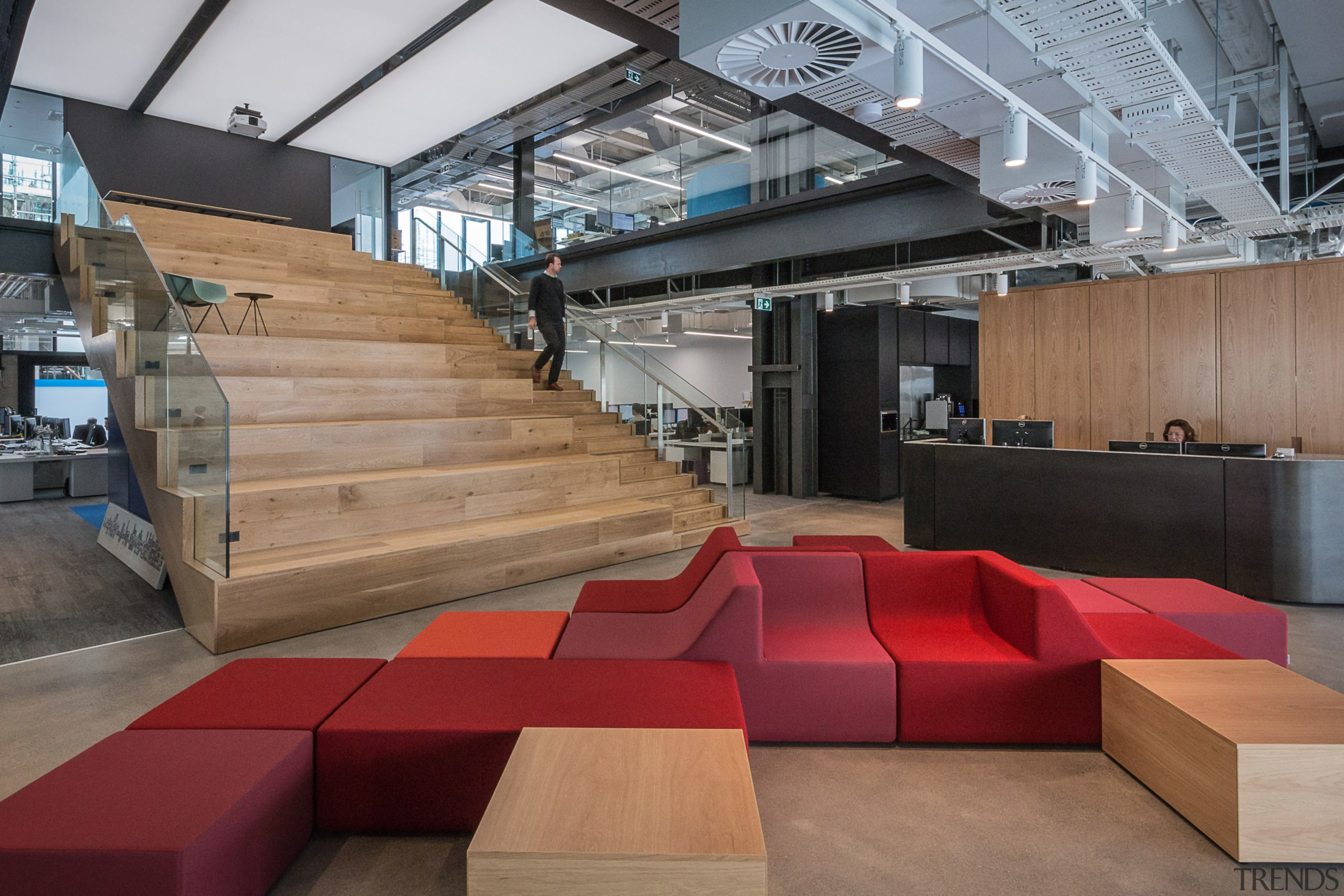 Colourful modular furniture, a timber auditorium staircase and architecture, floor, furniture, interior design, table, wood, gray