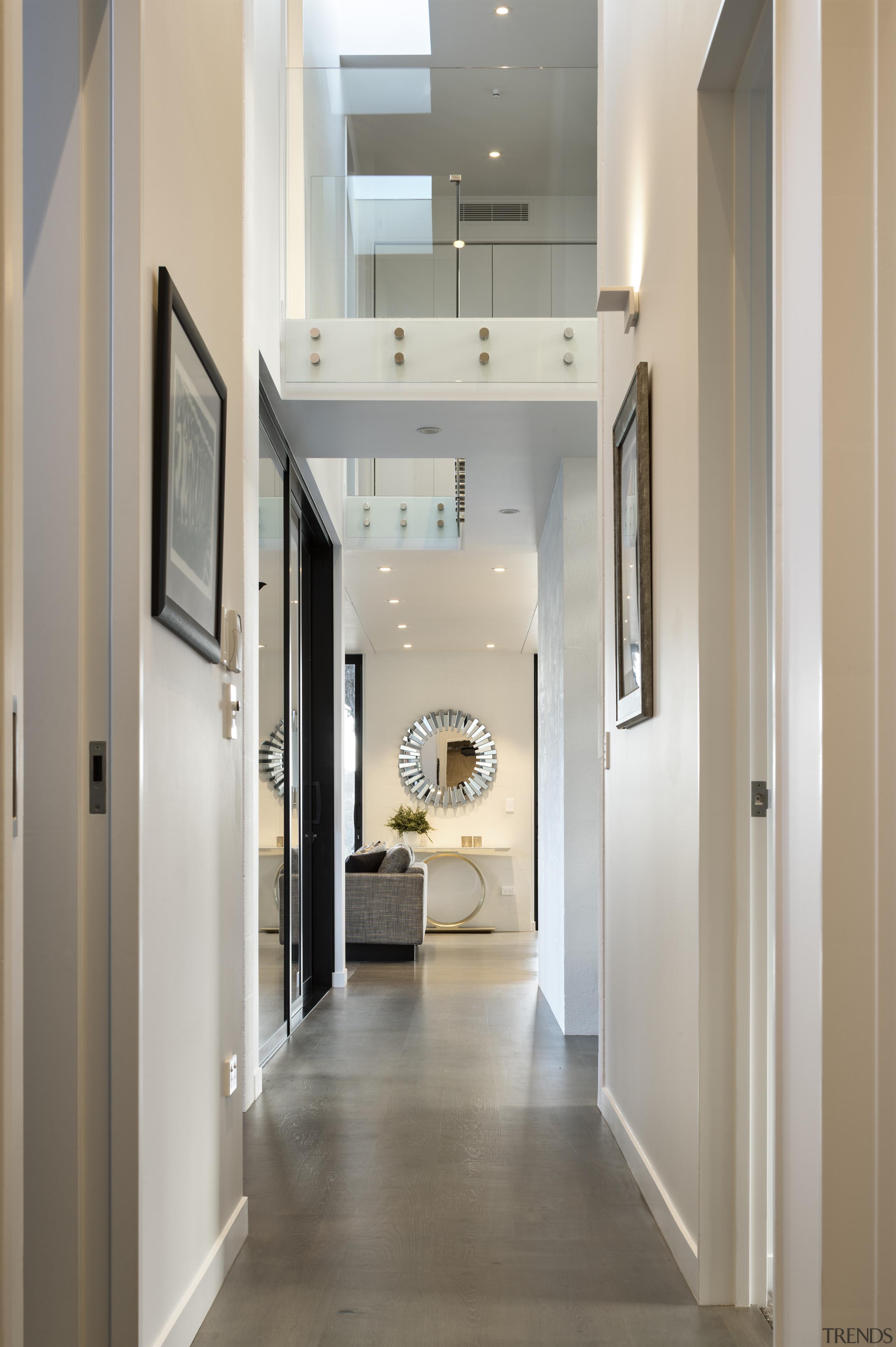 New two-storey coastal home, with upper level bridge ceiling, floor, flooring, hall, interior design, gray