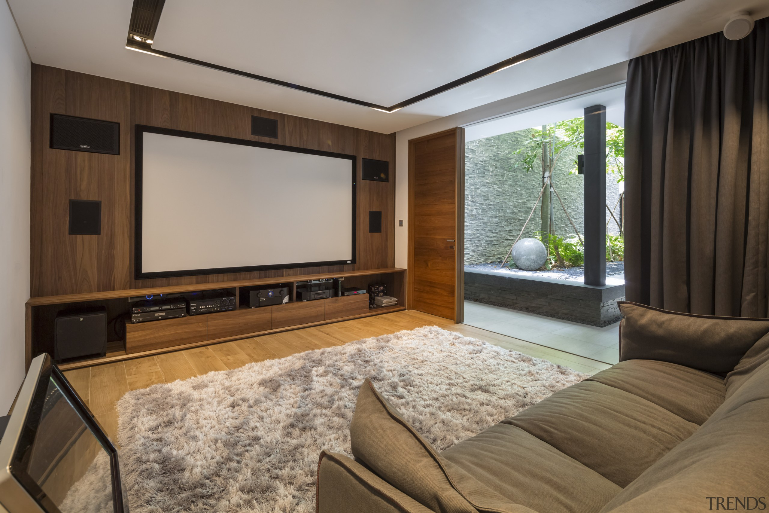 While this entertainment room is at basement level ceiling, home, interior design, living room, property, real estate, room, window, gray, brown