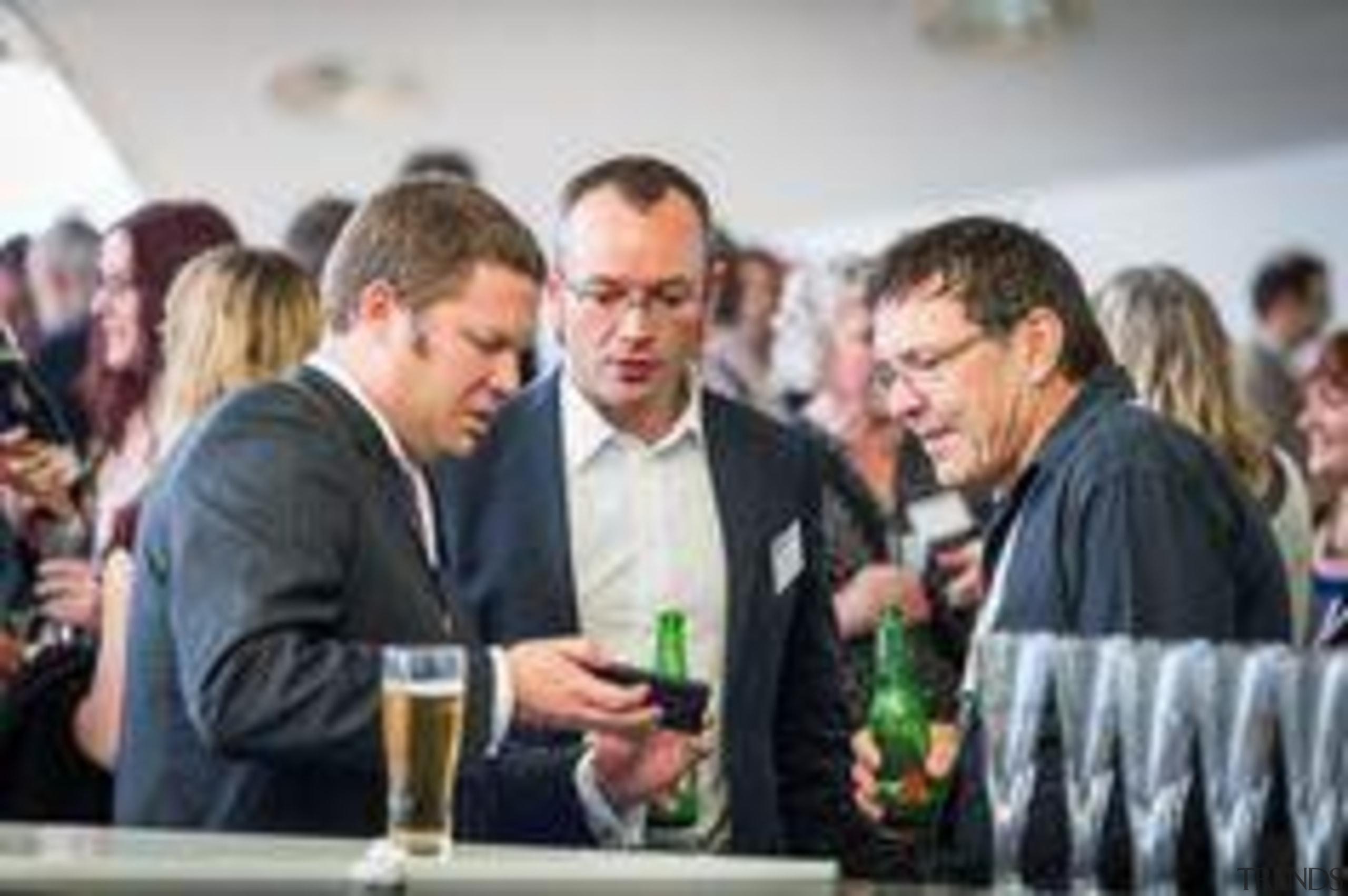 Matteo Messorri, Laminam Italy; Murray Christensen, Laminex New alcoholic beverage, communication, distilled beverage, drink, event, gray