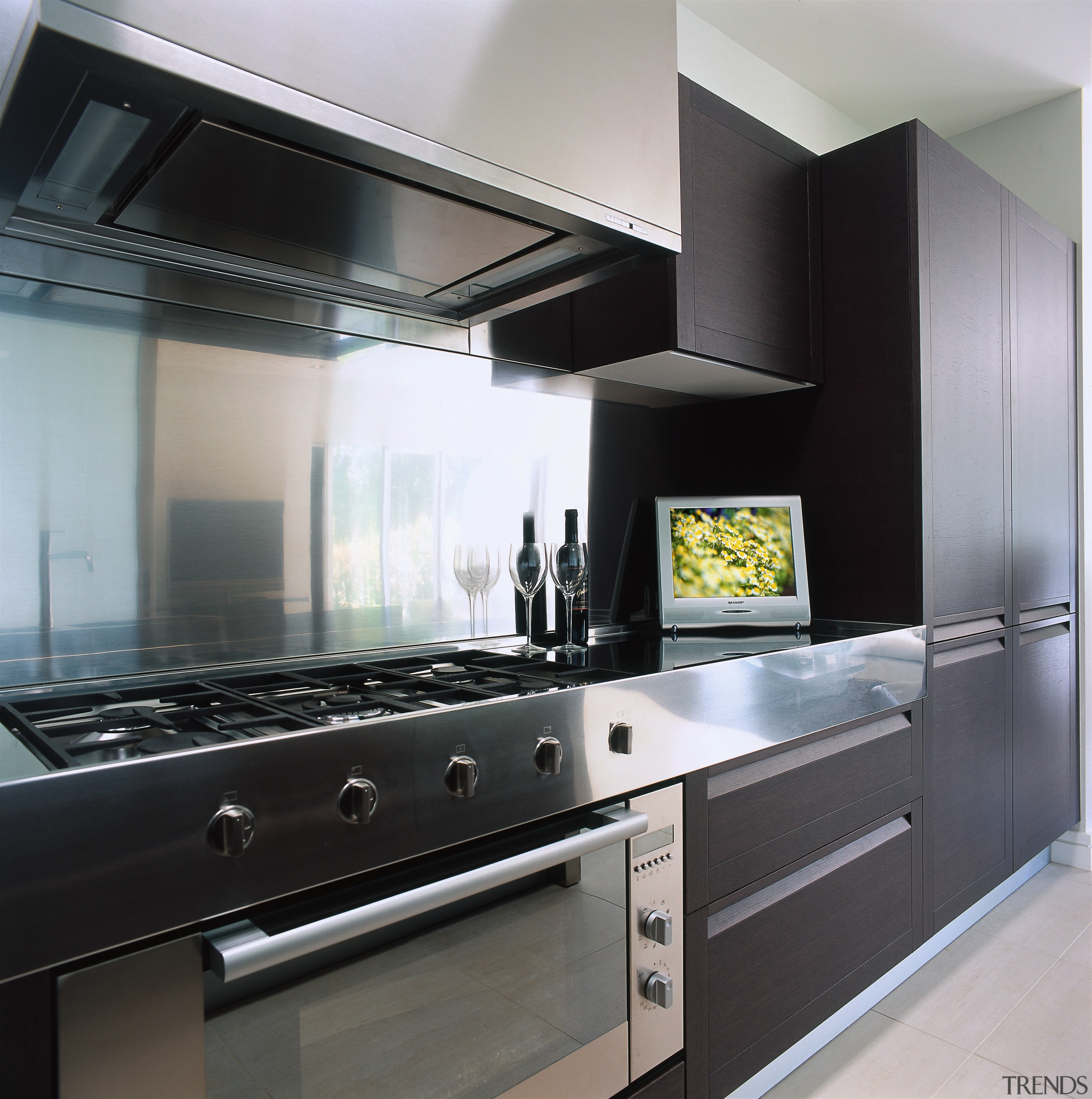 view of this sharp 15 inch lcd television cabinetry, countertop, cuisine classique, home appliance, interior design, kitchen, kitchen appliance, kitchen stove, major appliance, gray, black