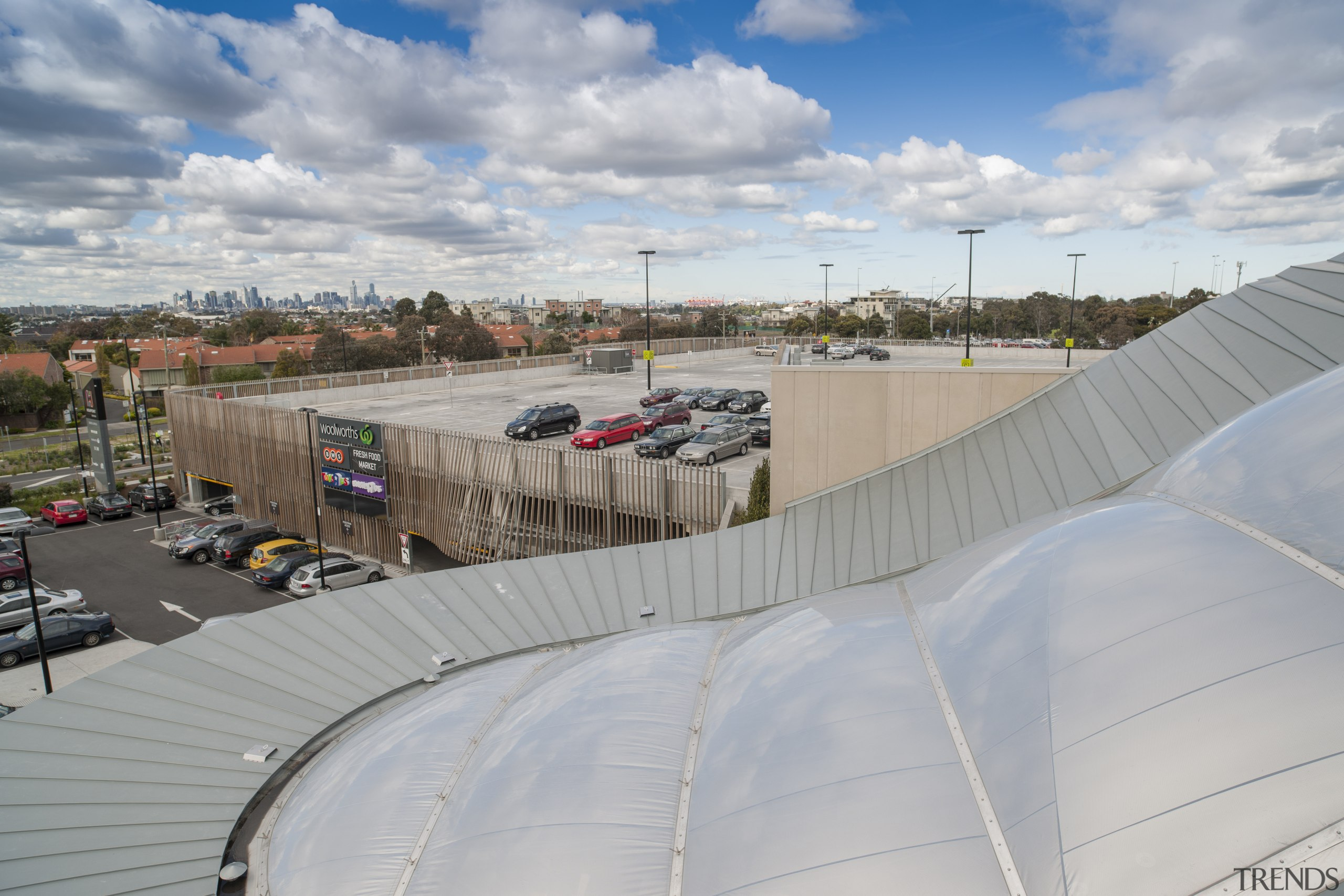 The roof was chosen in part for its atmosphere of earth, real estate, roof, sky, structure, gray