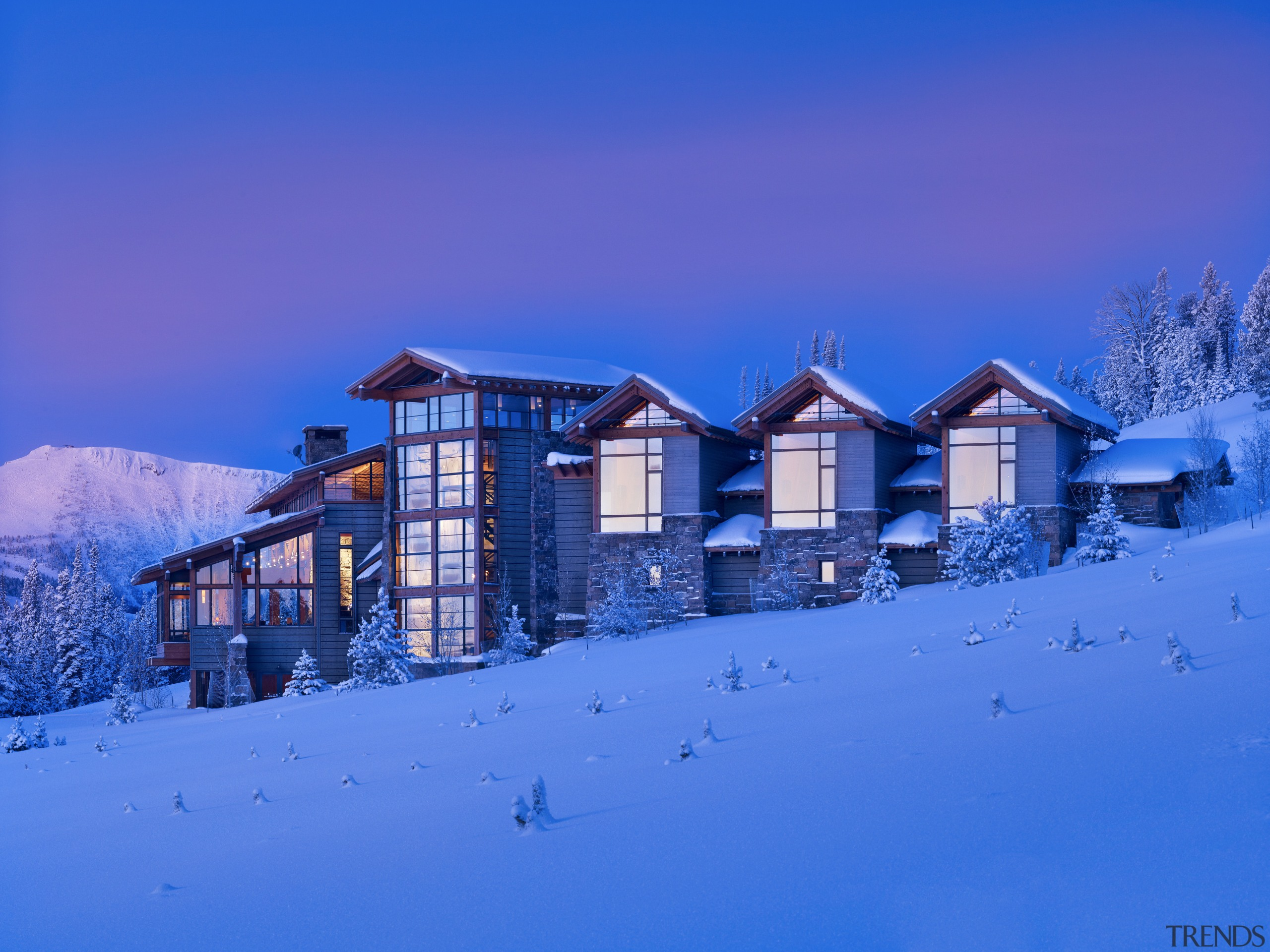 Gabled roofs and weatherboards abound in this Montana alps, arctic, atmosphere, blue, building, cloud, evening, freezing, home, house, light, log cabin, morning, mountain, mountain range, real estate, sky, snow, winter, blue