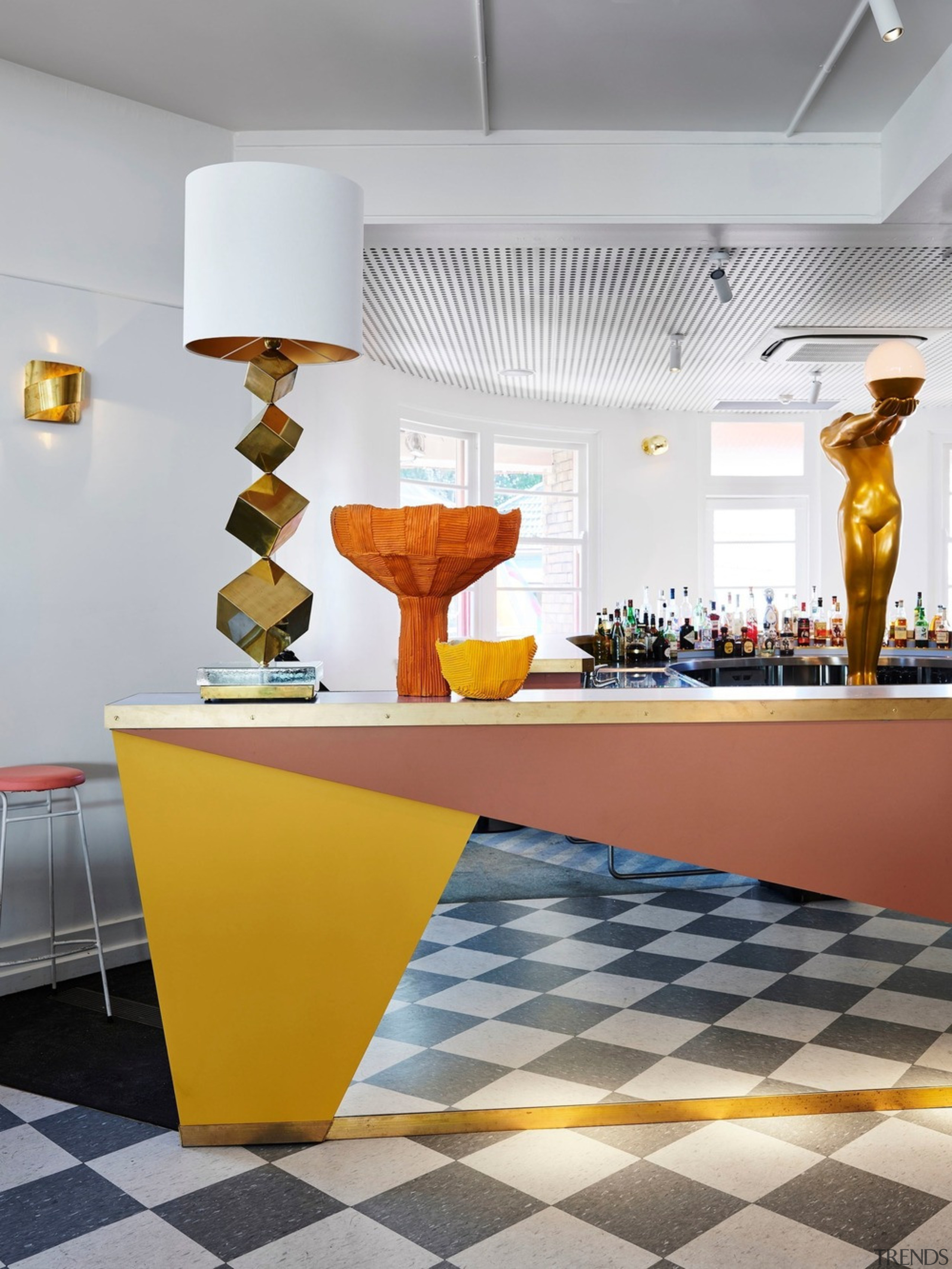The irregularly shaped main bar finished in coloured architecture, ceiling, countertop, floor, flooring, furniture, interior design, table, tile, wall, yellow, gray