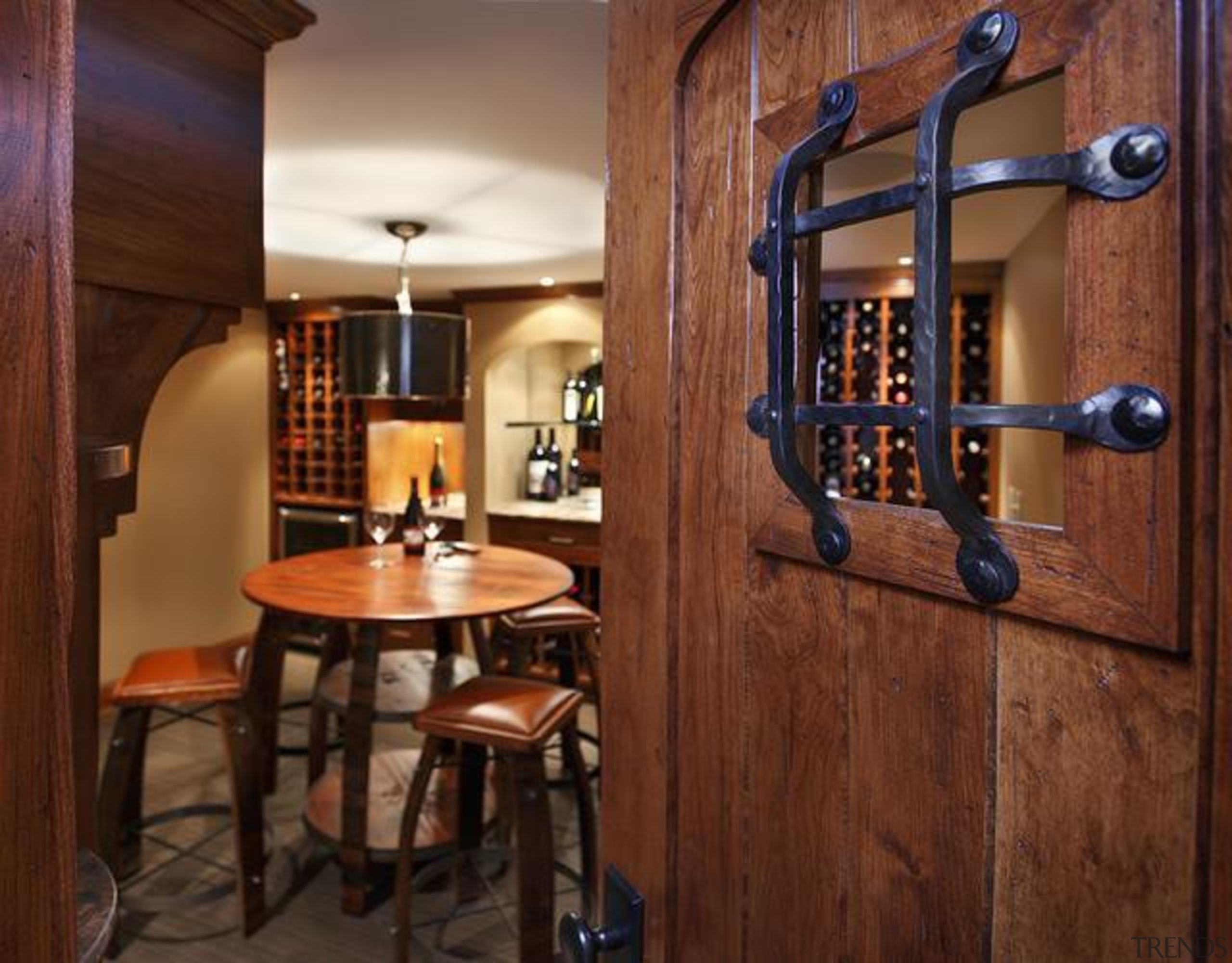 Because of its expansive and wide-open layout, a cabinetry, countertop, interior design, wine cellar, brown, red