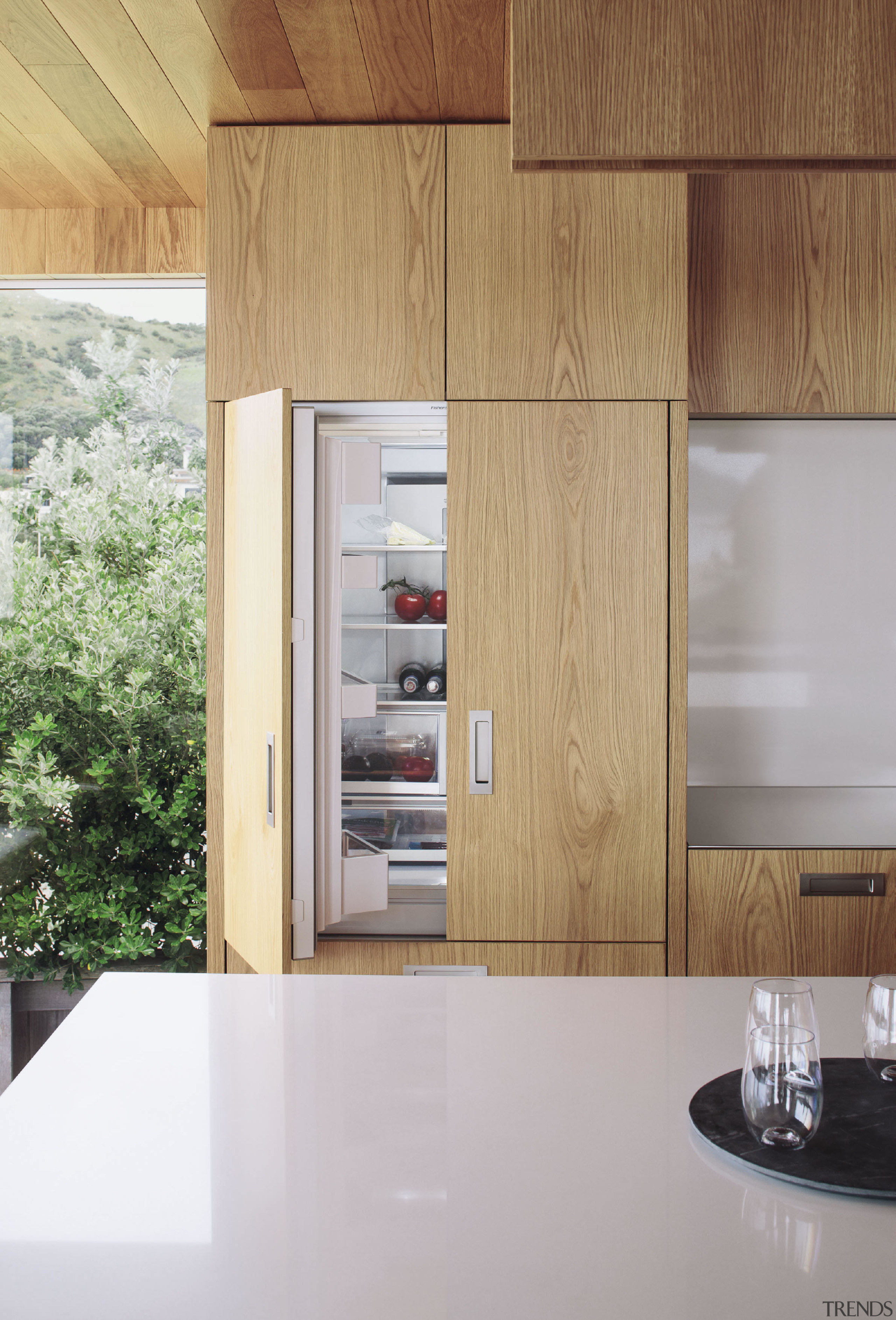 On this project by architect Paul Clark American cabinetry, countertop, floor, interior design, kitchen, gray