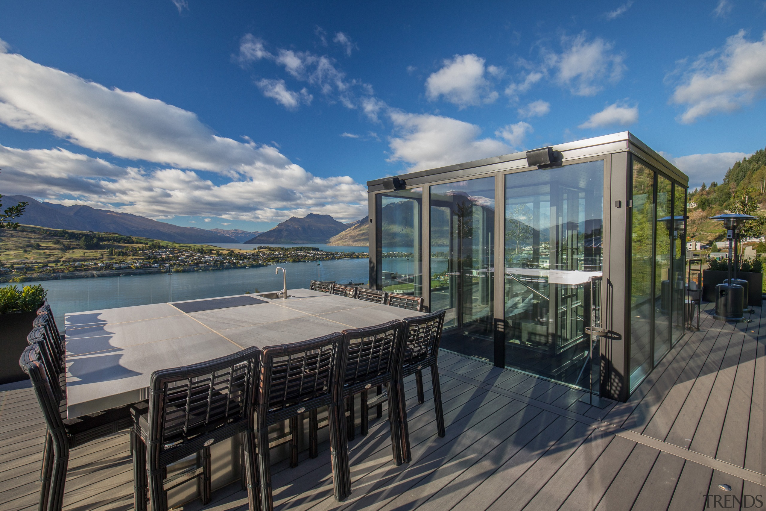 Visitors riding in this Queenstown home's glass-walled elevator Gary Todd Architecture, home, house, lakeside home,  water views, Queenstown