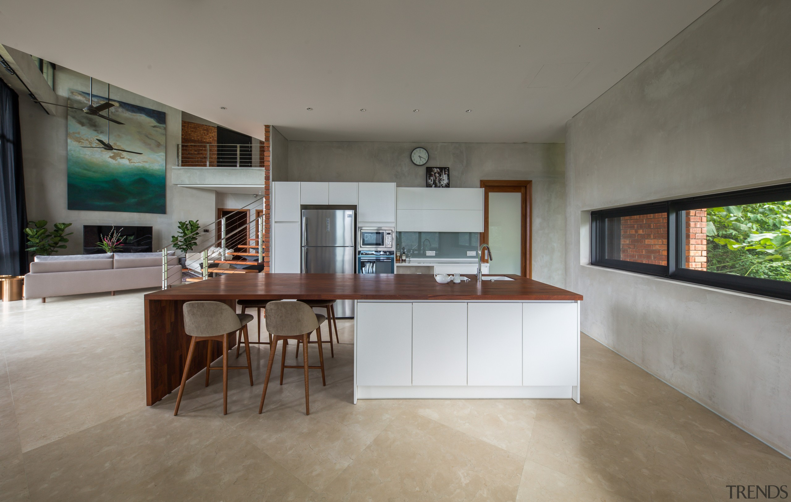 Crisp and contemporary, the kitchen is handy to architecture, building, cabinetry, ceiling, concrete, countertop, daylighting, floor, flooring, furniture, hardwood, home, house, interior design, kitchen, living room, loft, property, real estate, room, table, tile, wood flooring, gray
