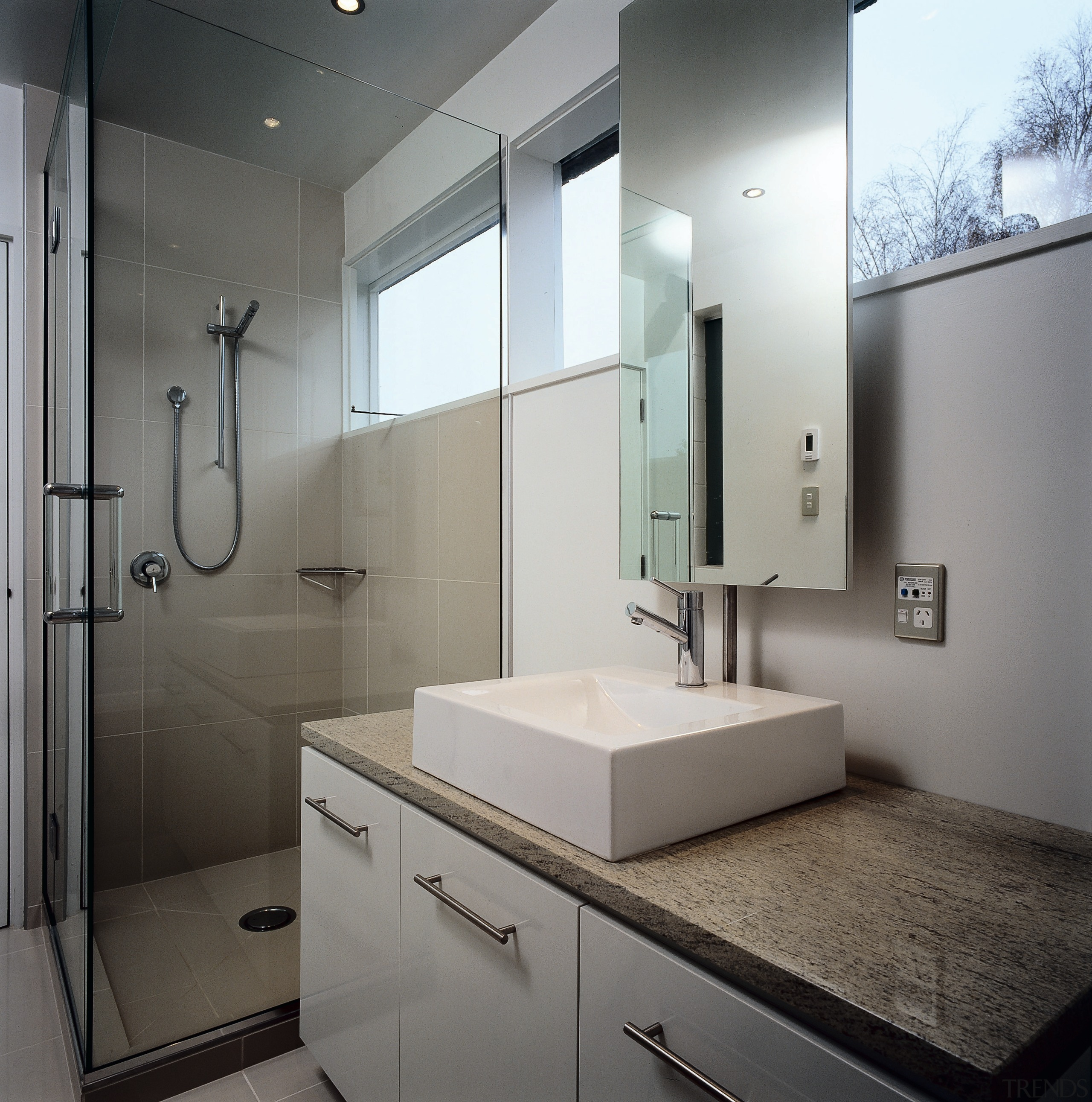 The main bathroom of a home, showing the architecture, bathroom, bathroom accessory, bathroom cabinet, home, interior design, product design, room, sink, gray