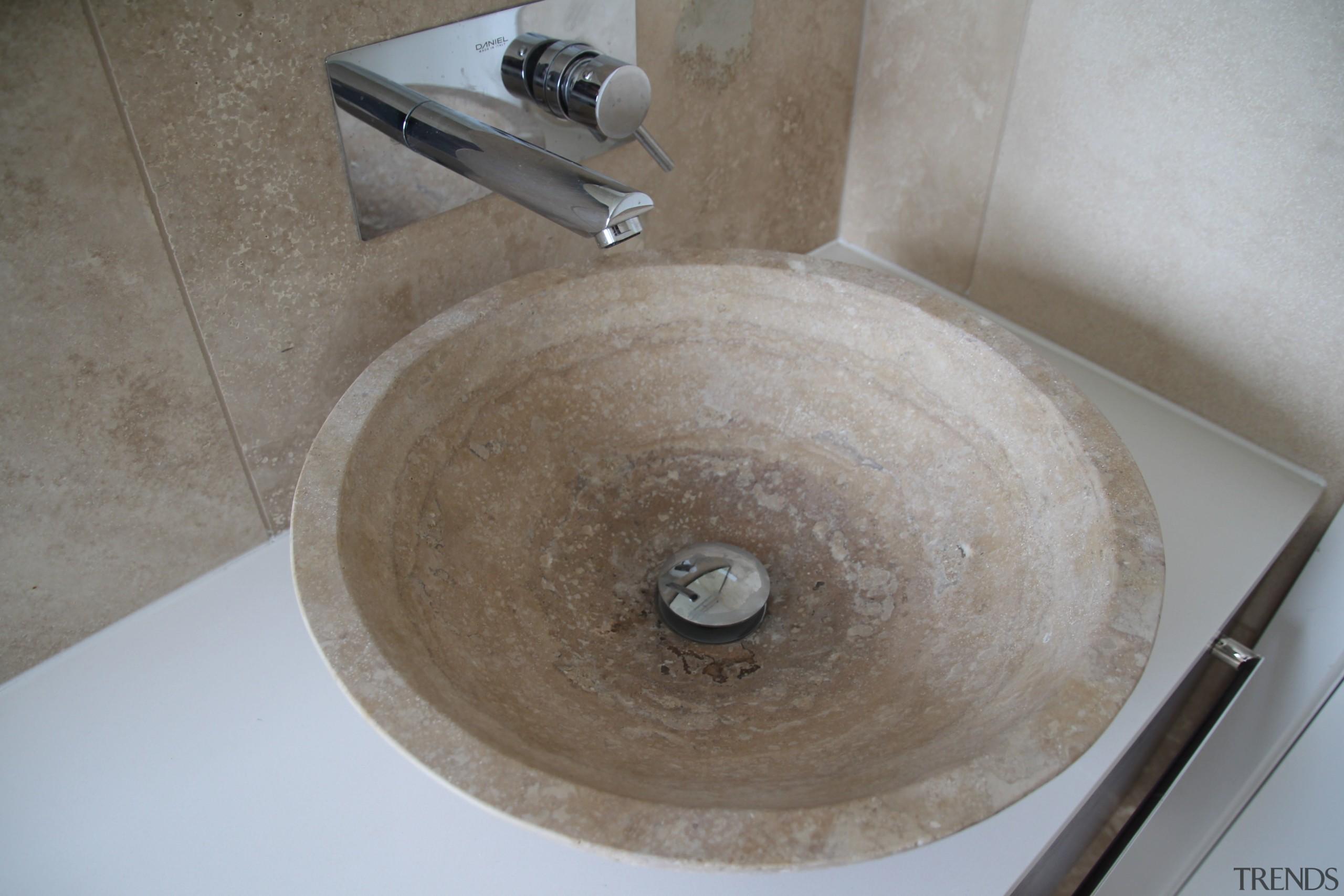 The table-top vanity basin in this bathroom is bathroom sink, plumbing fixture, sink, gray