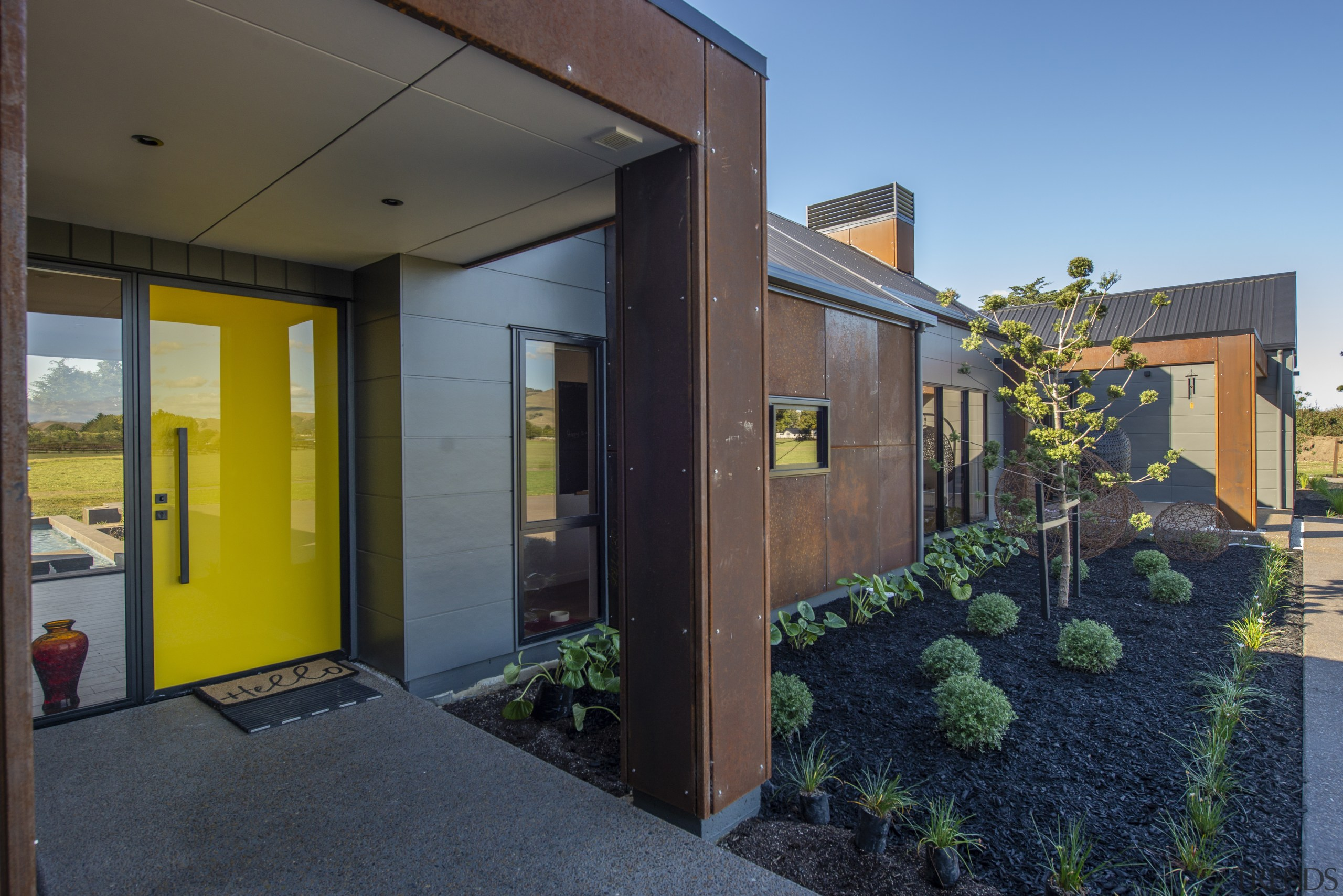 Corten steel panel cladding is a feature of black