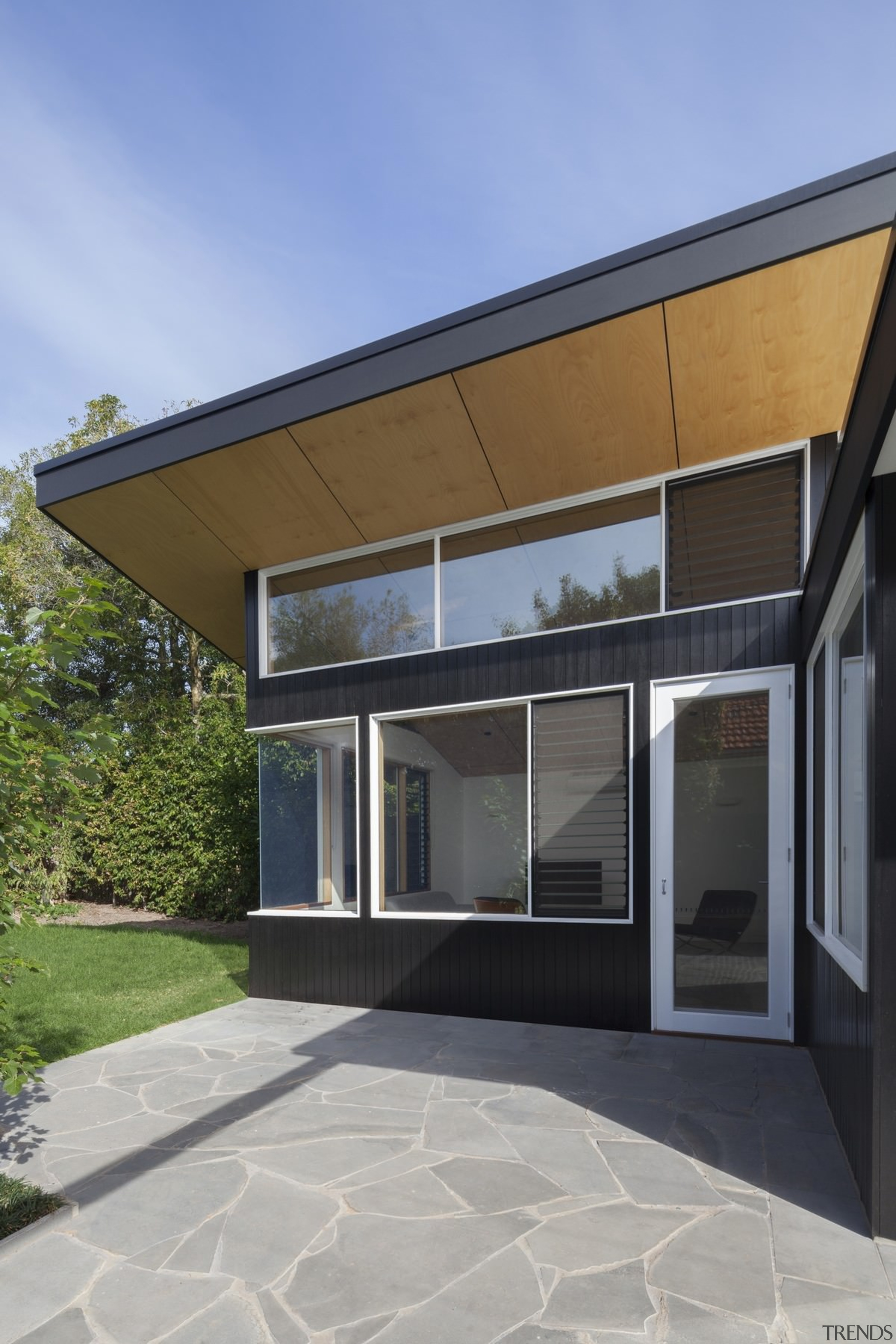 This large wood soffit runs around the living architecture, building, daylighting, elevation, facade, home, house, property, real estate, residential area, siding, villa, window, gray, teal