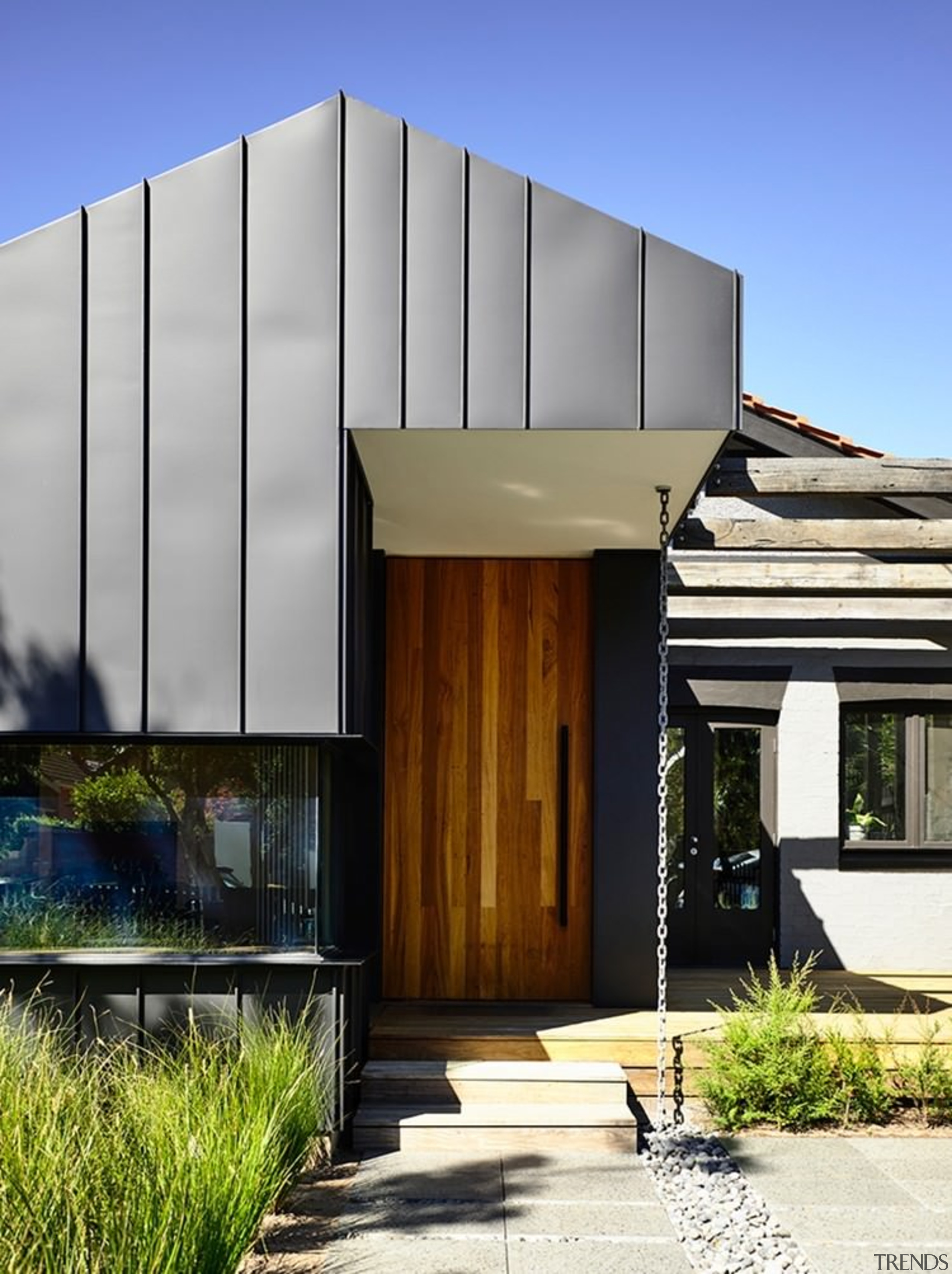 A pitched roof sits above the timber door architecture, building, elevation, facade, home, house, property, real estate, residential area, gray