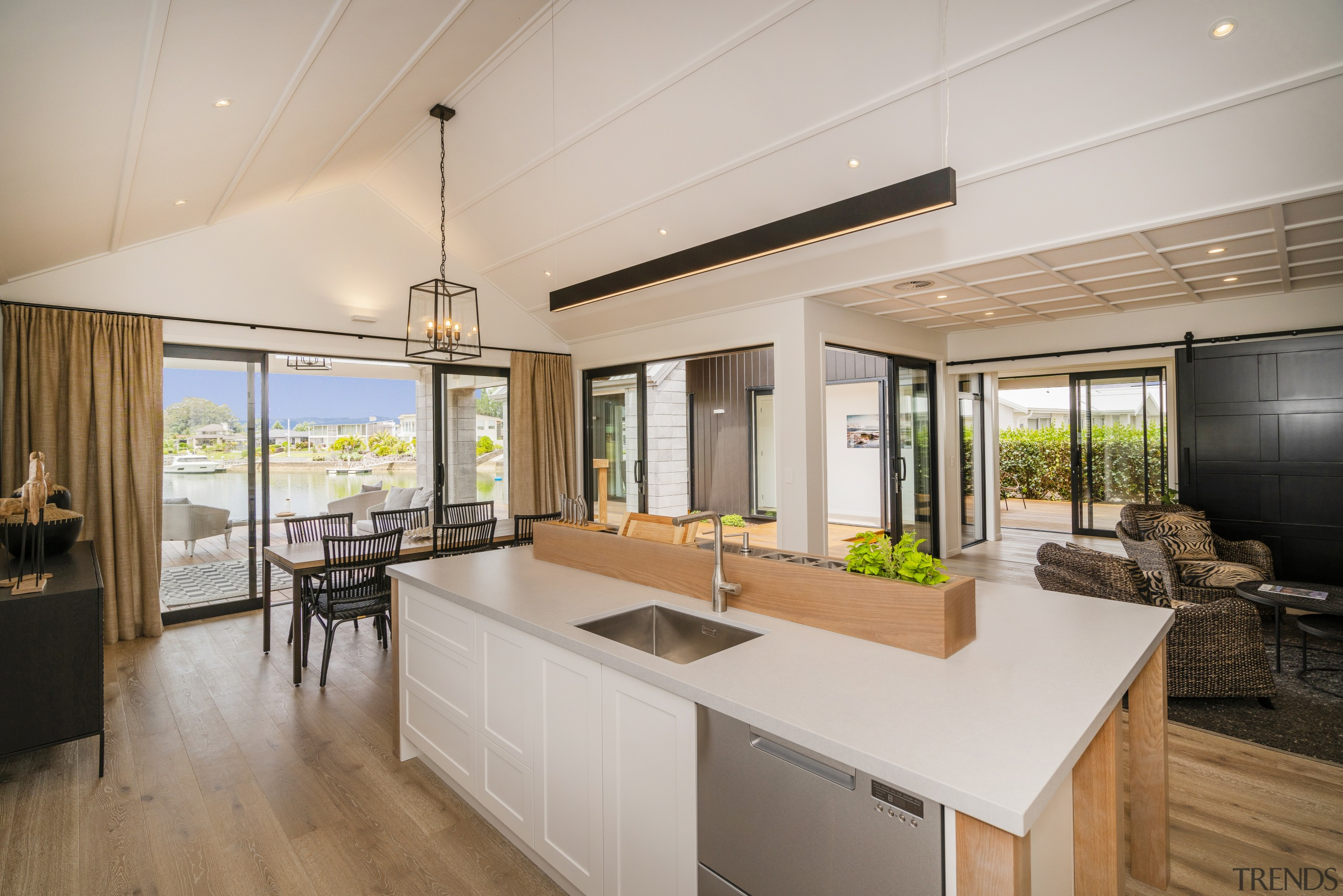Open sesame. Covered pavilions straight ahead and to countertop, house, interior design, kitchen, Landmark Homes,  Showhome, Coromandel, timber flooring