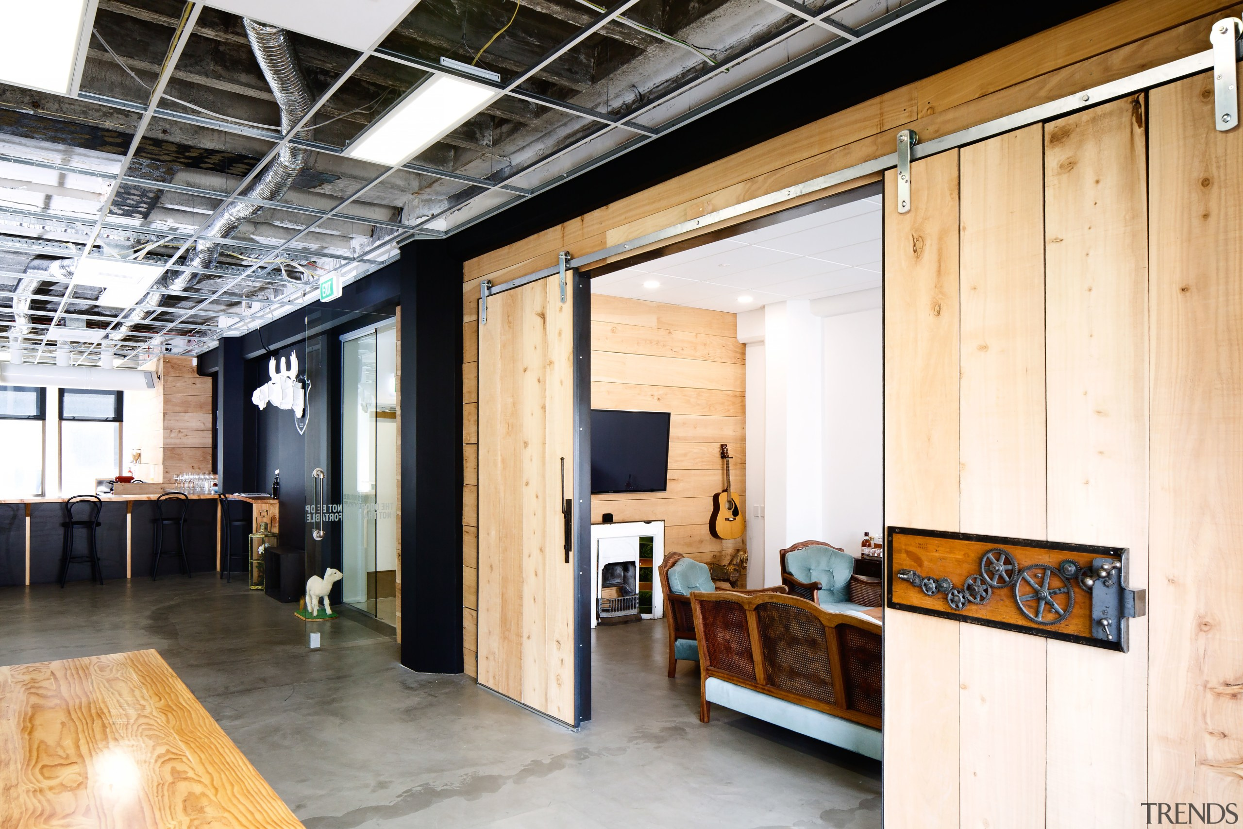 The informal visitor reception area at EightyOne is ceiling, interior design, loft, wood, white